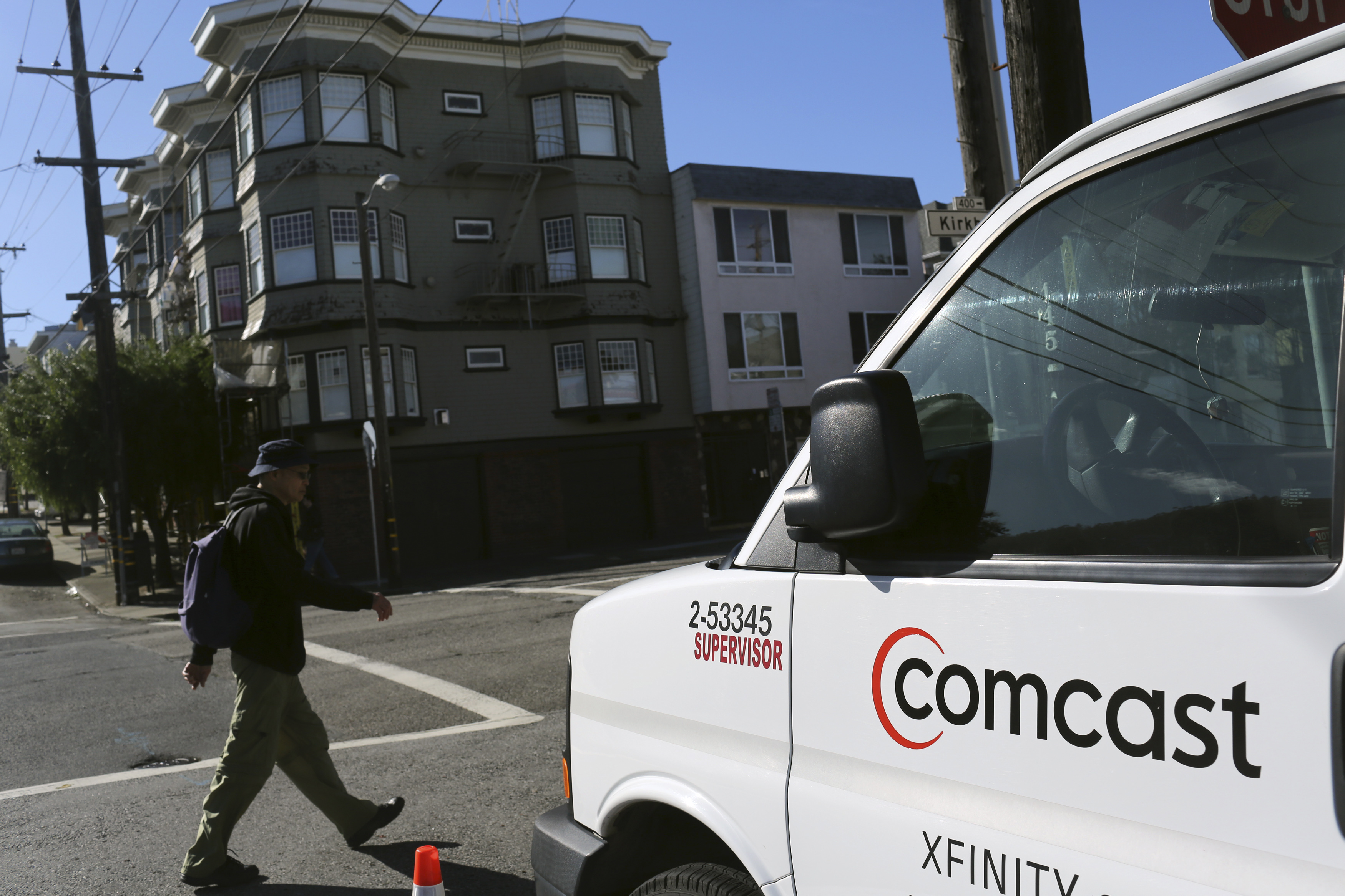 A Comcast sign is shown on the side of a vehicle in San Francisco, California February 13, 2014. Comcast Corp's proposed $45.2 billion takeover of Time Warner Cable Inc could face close scrutiny from U.S. antitrust regulators because of the deal's potential to reshape the country's pay TV and broadband markets.   REUTERS/Robert Galbraith  (UNITED STATES - Tags: MEDIA BUSINESS) - RTX18RVC