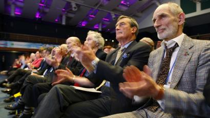 Delegates applaud a speech by George Osborne at the Conservative Party's spring forum.