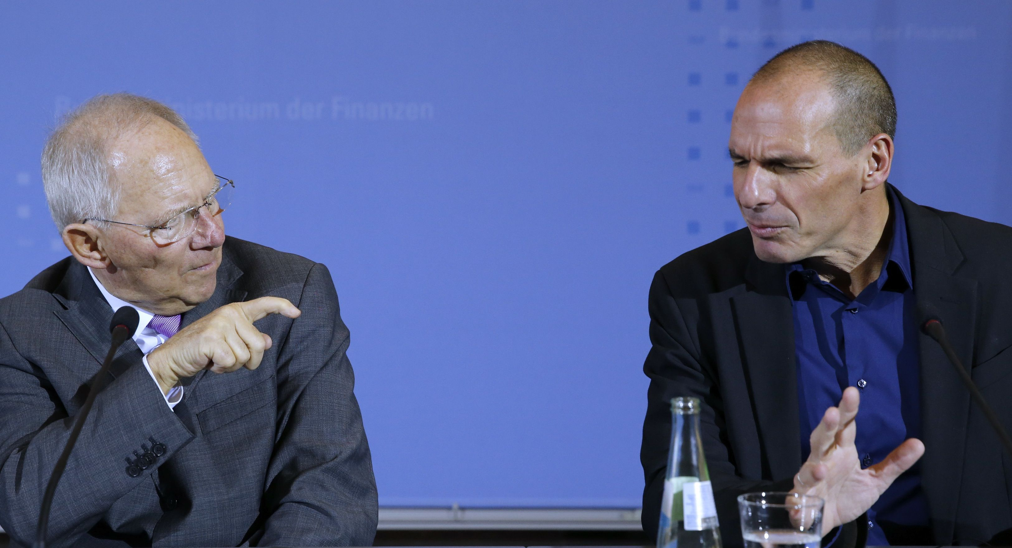 Greek Finance Minister Yanis Varoufakis and German Finance Minister Wolfgang Schaeuble (L) address a news conference following talks at the finance ministry in Berlin February 5, 2015. Promising to end five years of austerity, Greek Prime Minister Alexis Tsipras and Varoufakis, are meeting senior officials across Europe to seek support for a new debt agreement.    REUTERS/Fabrizio Bensch (GERMANY  - Tags: BUSINESS POLITICS TPX IMAGES OF THE DAY)   - RTR4OC3E