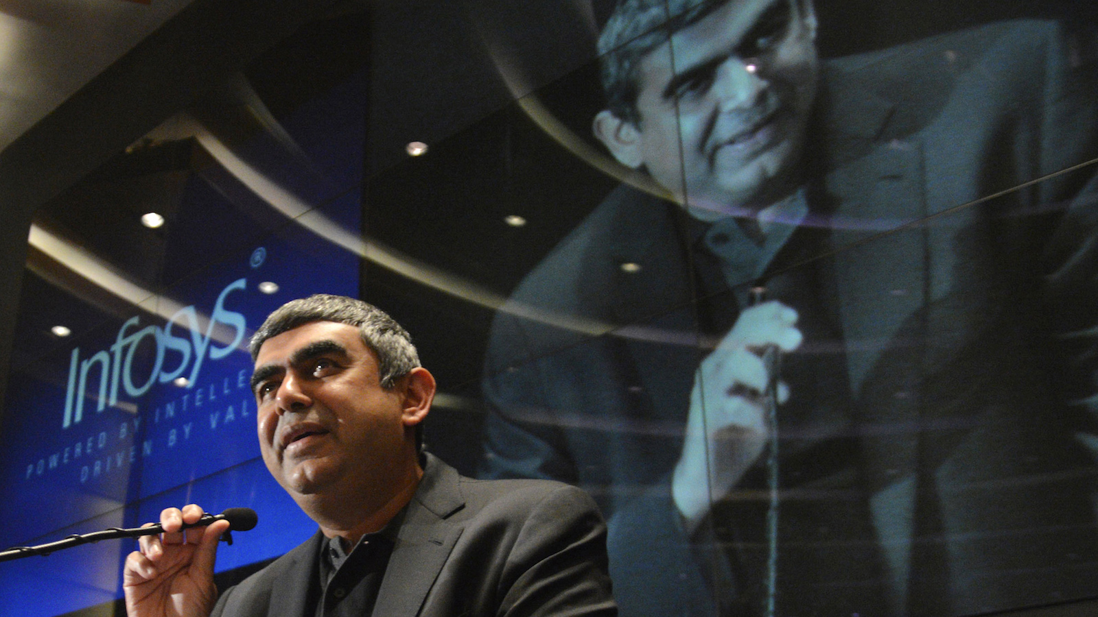 Newly appointed Infosys Chief Executive Officer Vishal Sikka speaks during a news conference at the company's headquarters in the southern Indian city of Bangalore June 12, 2014. Infosys Ltd, India's second-largest IT services exporter, has for the first time picked an outsider as chief executive officer, as it seeks to boost sales of high-margin services like cloud computing and stem a staff exodus. Sikka, a former member of executive board at German software company SAP AG, has the technical savvy to herald what analysts expect will be a strategy overhaul at Infosys, which, like its competitors Tata Consultancy Services Ltd and Wipro Ltd, has relied on labour-intensive, low-margin contracts from Western clients.