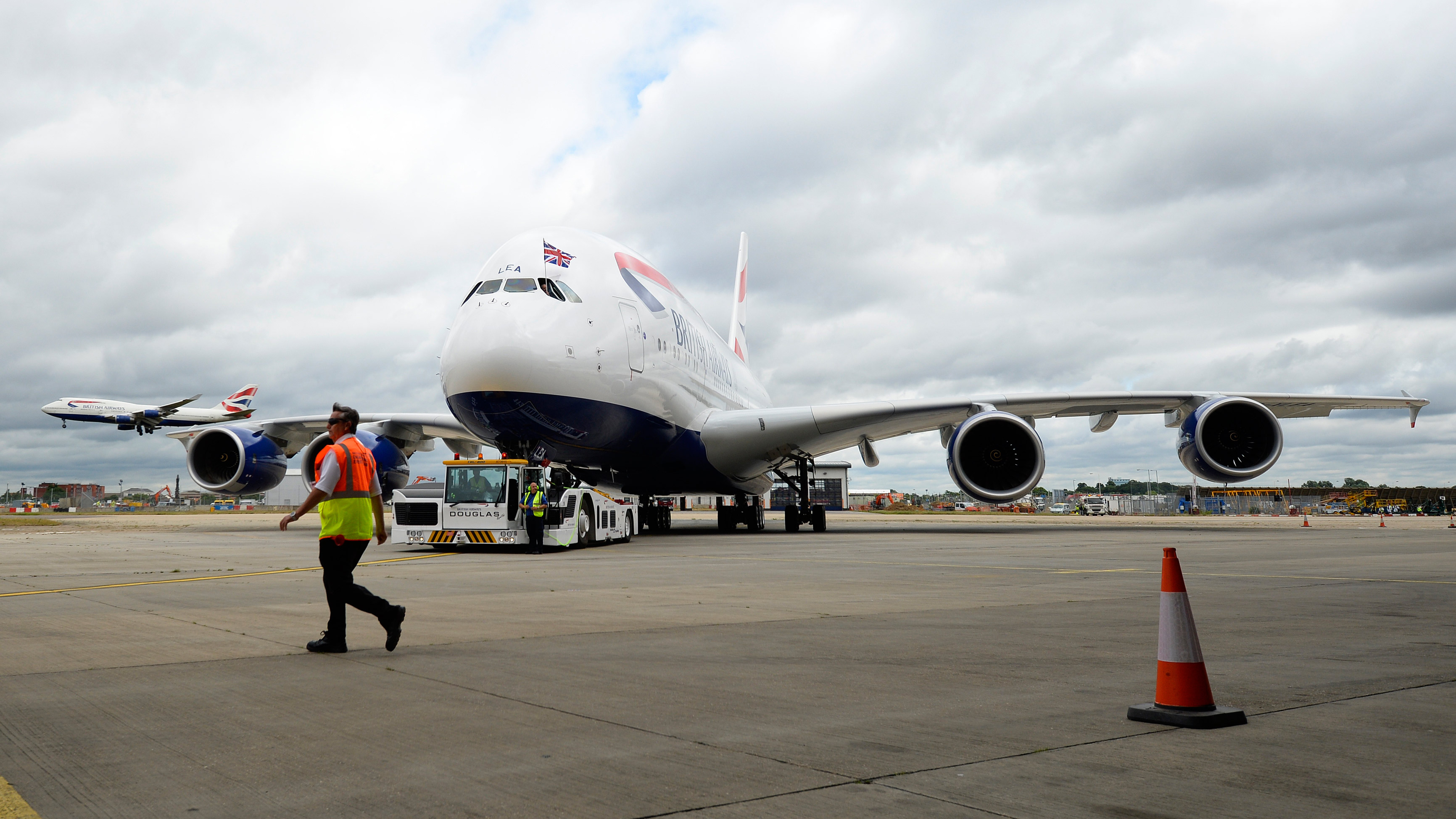 British Airways' new Airbus A380 is towed to a hanger after landing at Heathrow airport in London July 4, 2013. British Airways received its first Airbus A380 jet at Heathrow airport on Thursday, marking the start of modernising its aging fleet with new, more fuel-efficient planes able to better compete with fast-growing rivals.