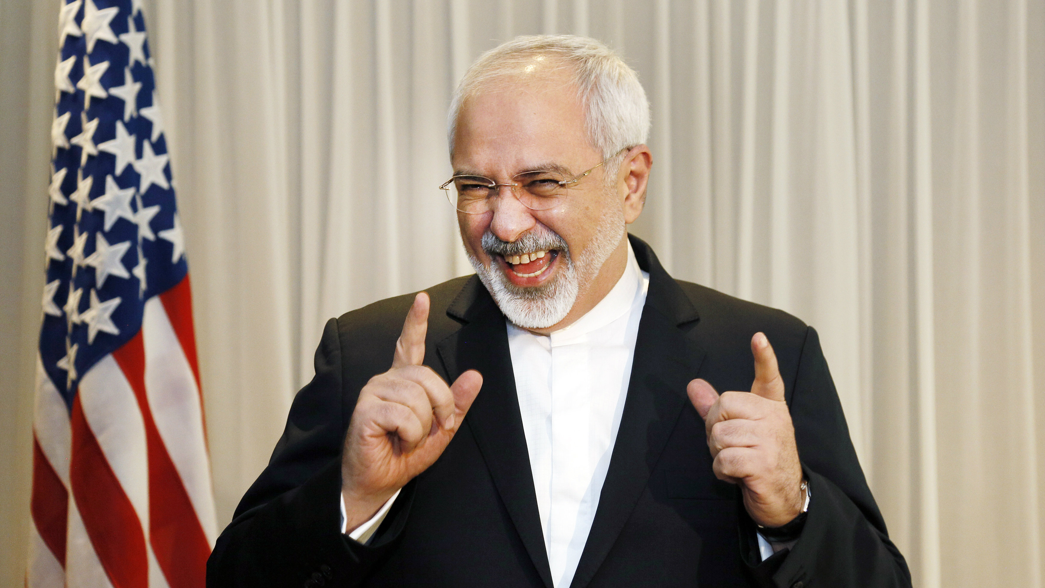 Iranian Foreign Minister Mohammad Javad Zarif talks with reporters before meeting with U.S. Secretary of State John Kerry in Geneva January 14, 2015.