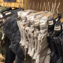 A rack of jeans hanging at Madewell