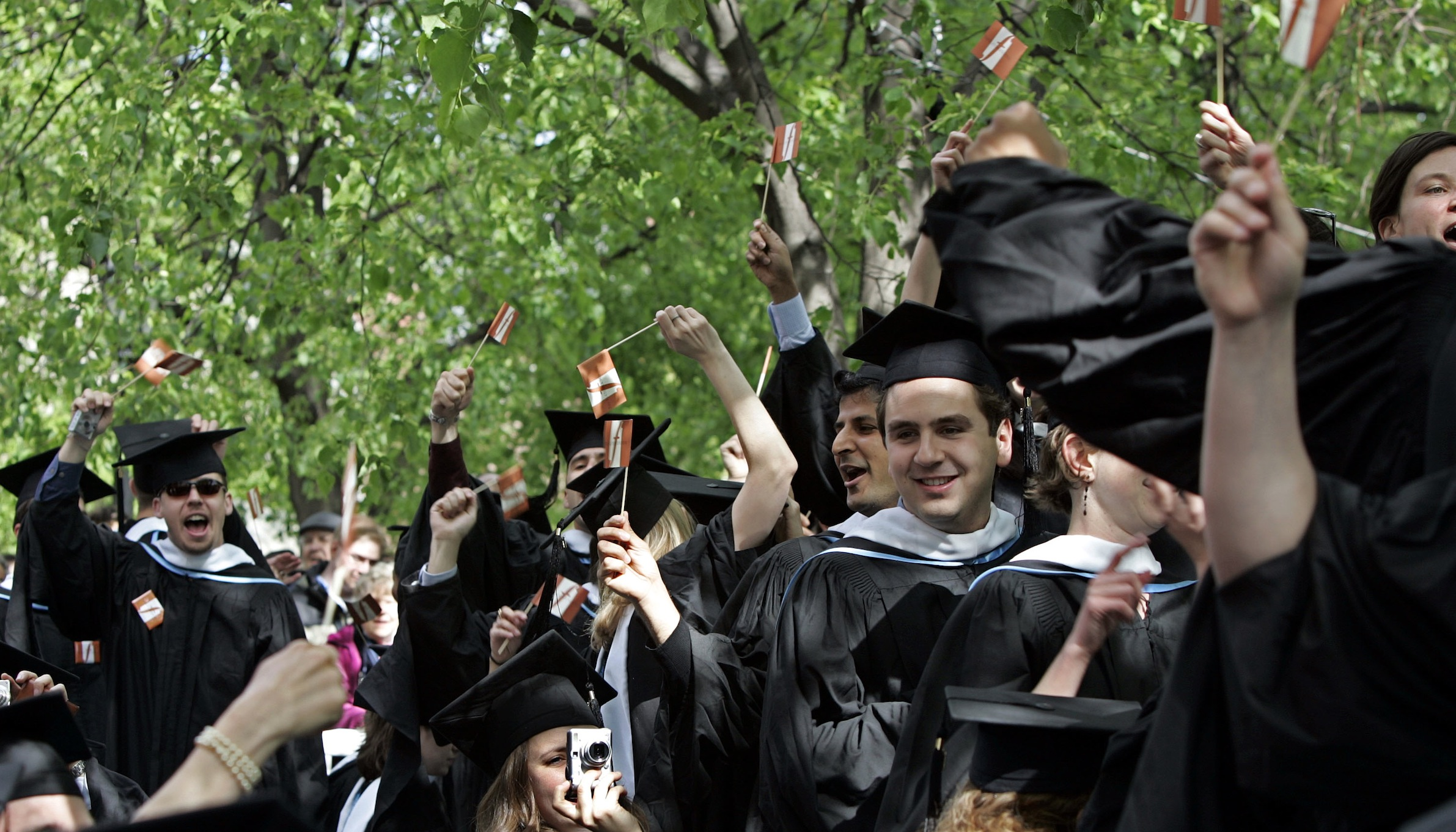 Tufts University Fletcher School of Law and Diplomacy students wave during Tufts University 150th commencement in Somerville, Mass., Sunday, May 21, 2006. (AP Photo/Chitose Suzuki)