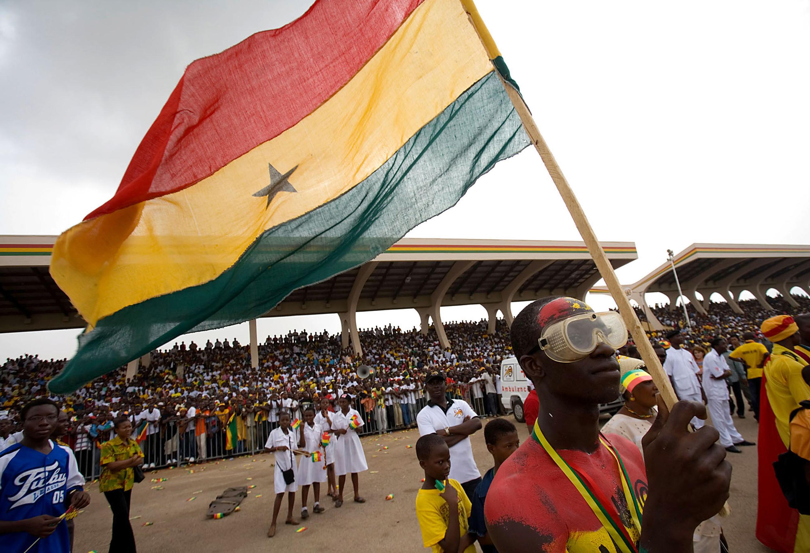 A man holds the Ghana flag