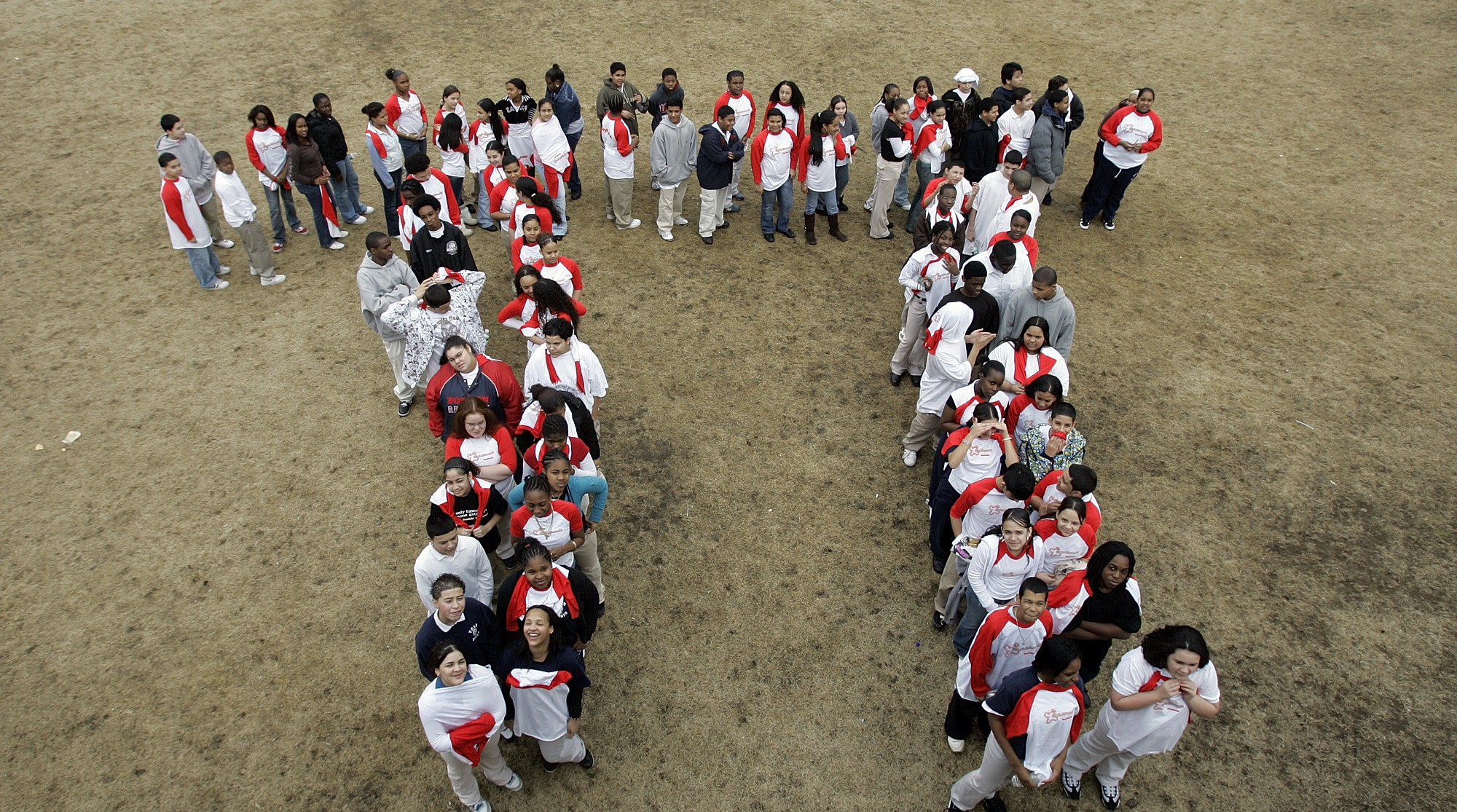 Students from the Maurice J. Tobin School makes a human Pi symbol  at the school in Boston, Tuesday, March, 13, 2007, during a celebration of Pi Day.  Pi Day is an unofficial holiday in the math community, observed each year on the 14th day of the third month.  (AP Photo/Chitose Suzuki)