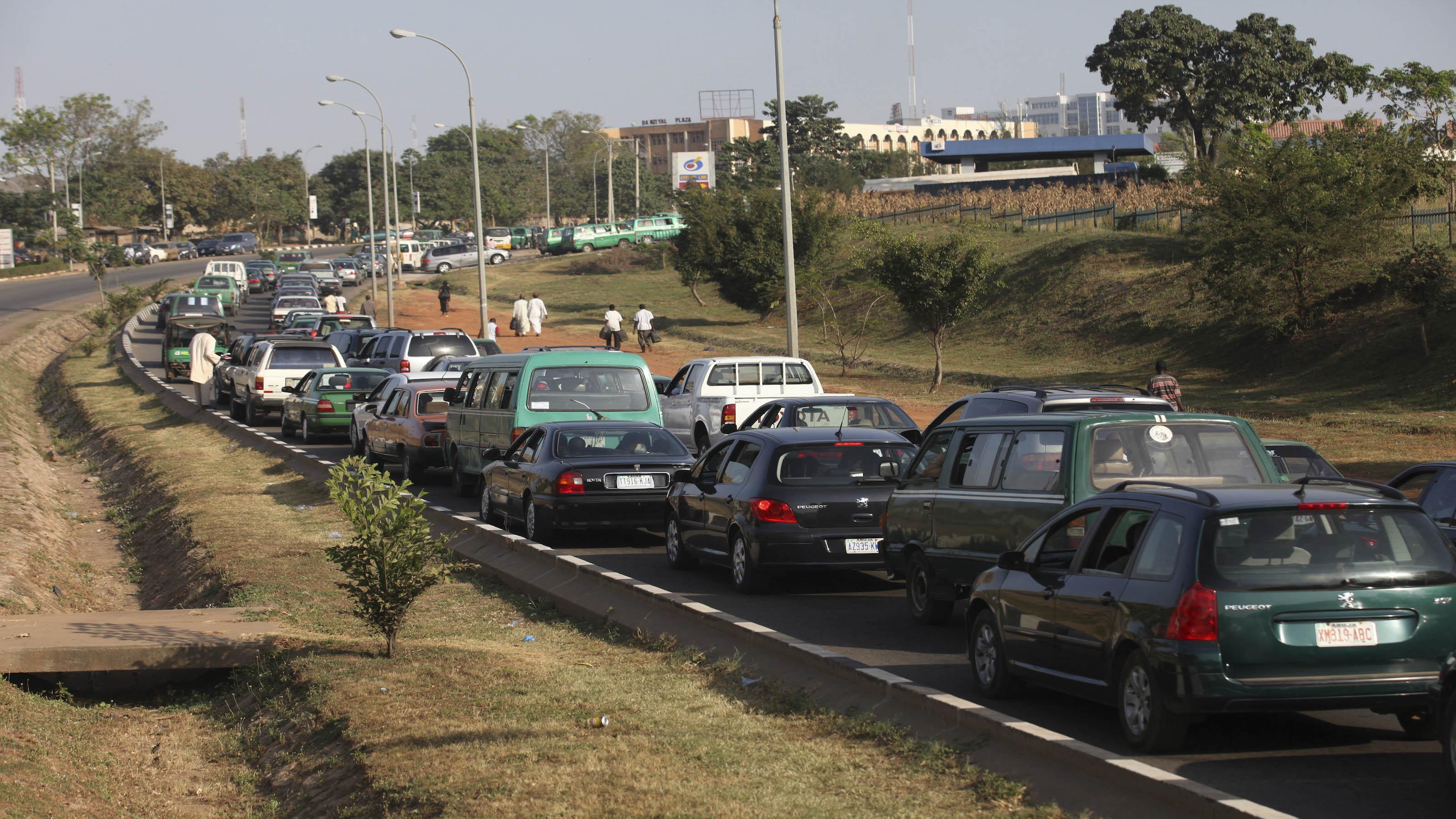 Cars queue to buy fuel in Abuja, Nigeria
