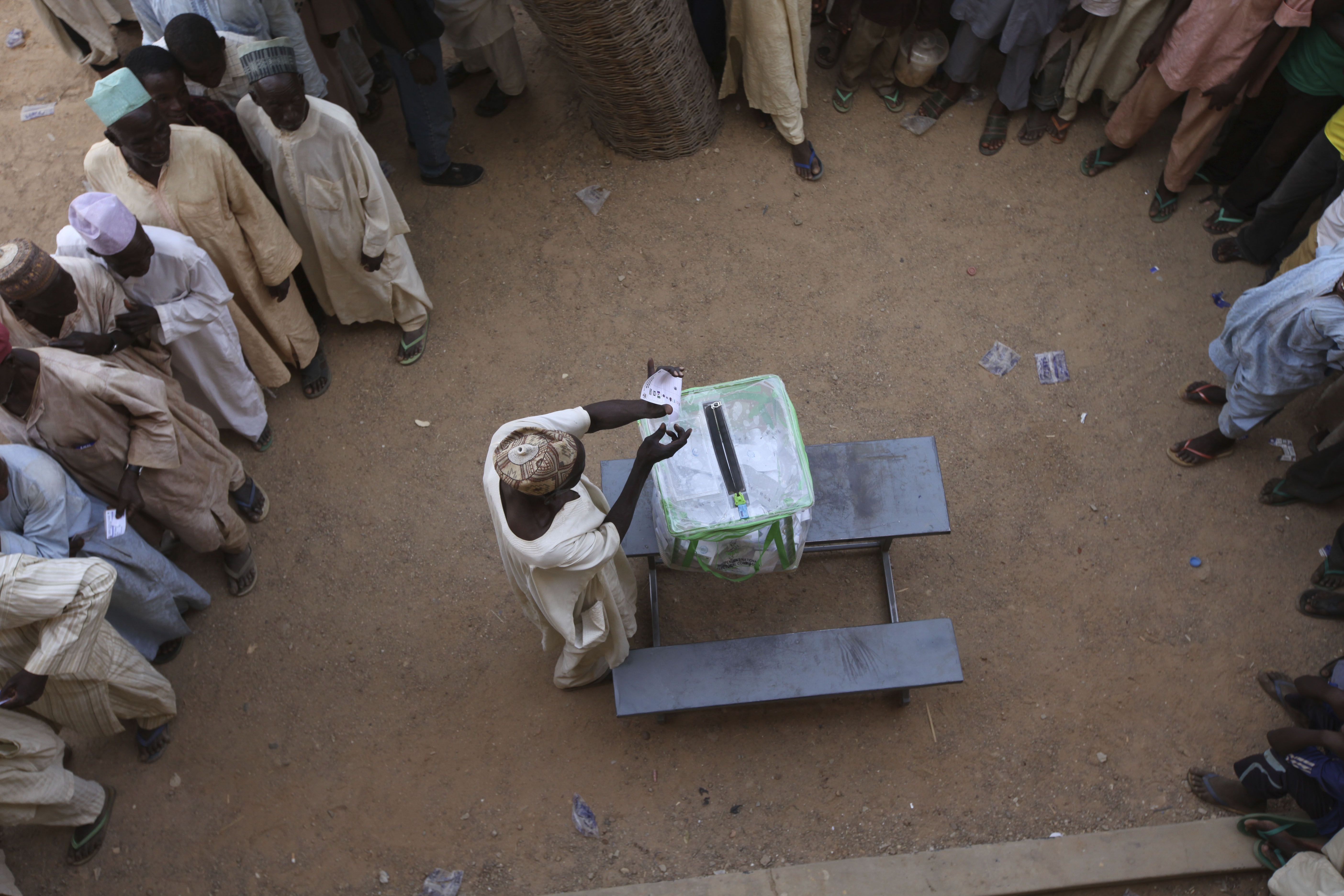 A man casts his vote during the presidential elections in Mashi, Nigeria