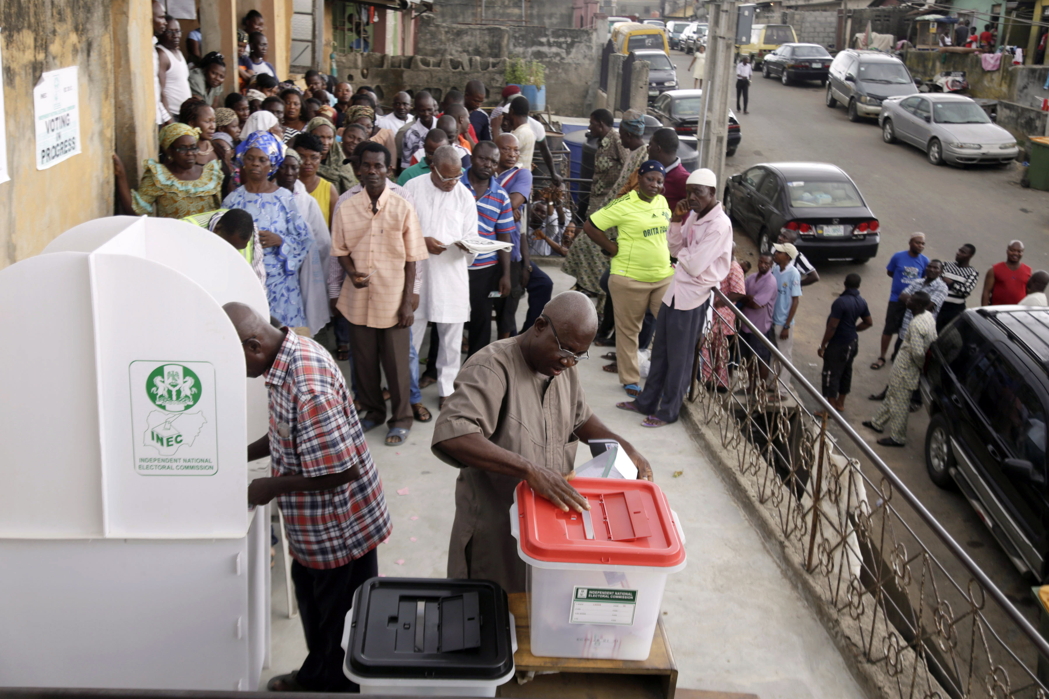 A man casts his ballot as Nigerians vote for a second day in Lagos, Nigeria, Sunday March 29, 2015. Voting in Nigeria's elections continued in certain areas on Sunday after technical problems prevented some people from casting their ballots on Saturday and despite extremist violence in the northeast and protests in the south. (AP Photo/Kunle Ogunfuyi)