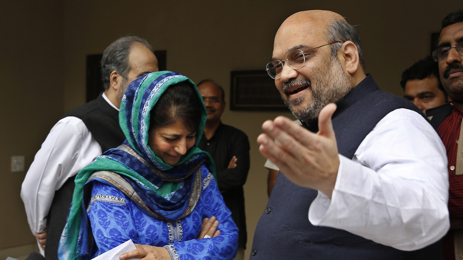 India's ruling Bharatiya Janata Party (BJP) president Amit Shah, right, gestures to the media after a meeting with Kashmir's regional Peoples' Democratic Party (PDP) leader Mehbooba Mufti, left in blue, in New Delhi, India, Tuesday, Feb. 24, 2015. The BJP and the PDP Tuesday finalized an agreement to form a coalition government in Kashmir, the first time the Hindu nationalist party will share a leadership position in the predominantly Muslim region. (AP Photo / Manish Swarup)