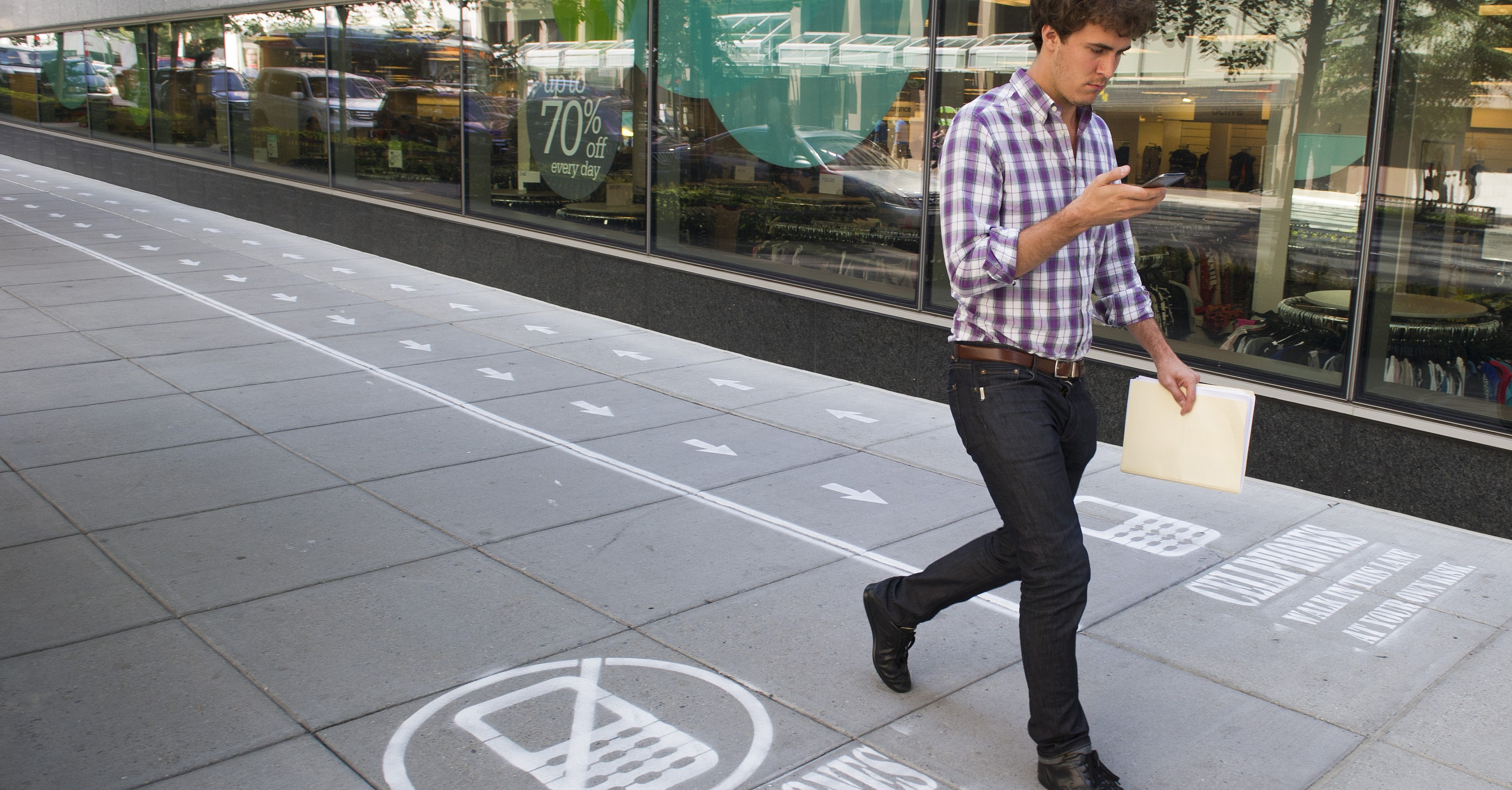 As part of their Mind Over Masses television show, National Geographic has divided a one block-long sidewalk into two sections; one for cell phone users and the other for those not using a cell phone in downtown Washington,