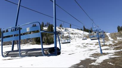 In this photo taken Wednesday, Jan. 28, 2015, a ski lift sits idle at the Donner Ski Ranch in Norden, Calif. Midway through California's ski season, the ranch is one of several ski resorts that have either suspended operations or cut back on the number of lifts operating due to the state's historic drought.