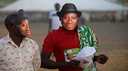 Supporters of Nigerian President Goodluck Jonathan, wear masks