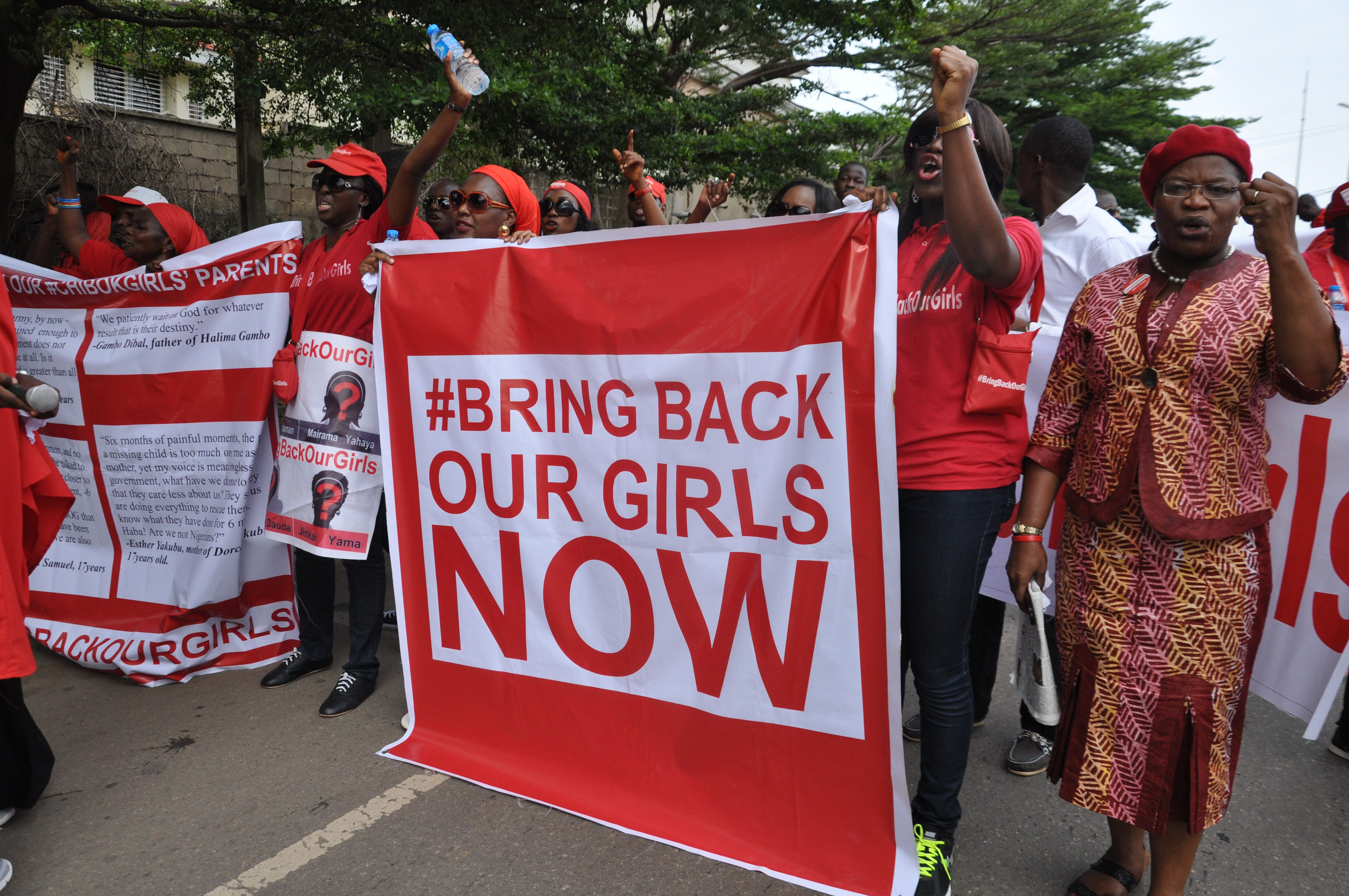 """People attend a demonstration calling on the government to rescue the kidnapped girls of the government secondary school in Chibok, in Abuja, Nigeria, Tuesday, Oct. 14, 2014. Scores of protesters marched chanting """"Bring Back Our Girls"""" kidnapped six months ago by Boko Haram . (AP Photo/ Olamikan Gbemiga)"""