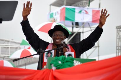 Nigeria President, Goodluck Jonathan, waves to his supporters