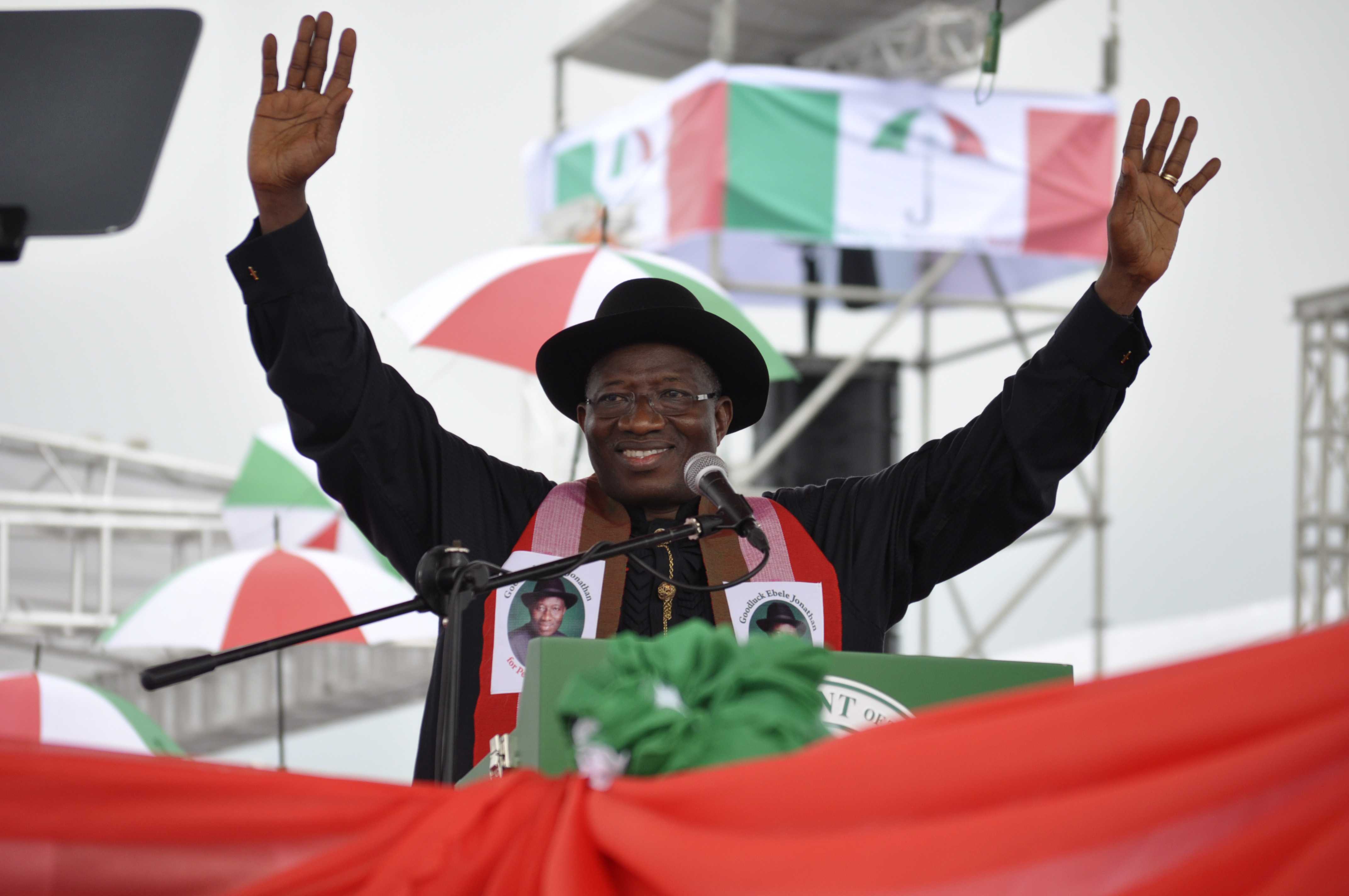 Nigeria President, Goodluck Jonathan, waves to his supporters during a political rally declaring his intention to run in next year's election in Abuja, Nigeria, Tuesday, Nov. 11, 2014, (AP Photo)