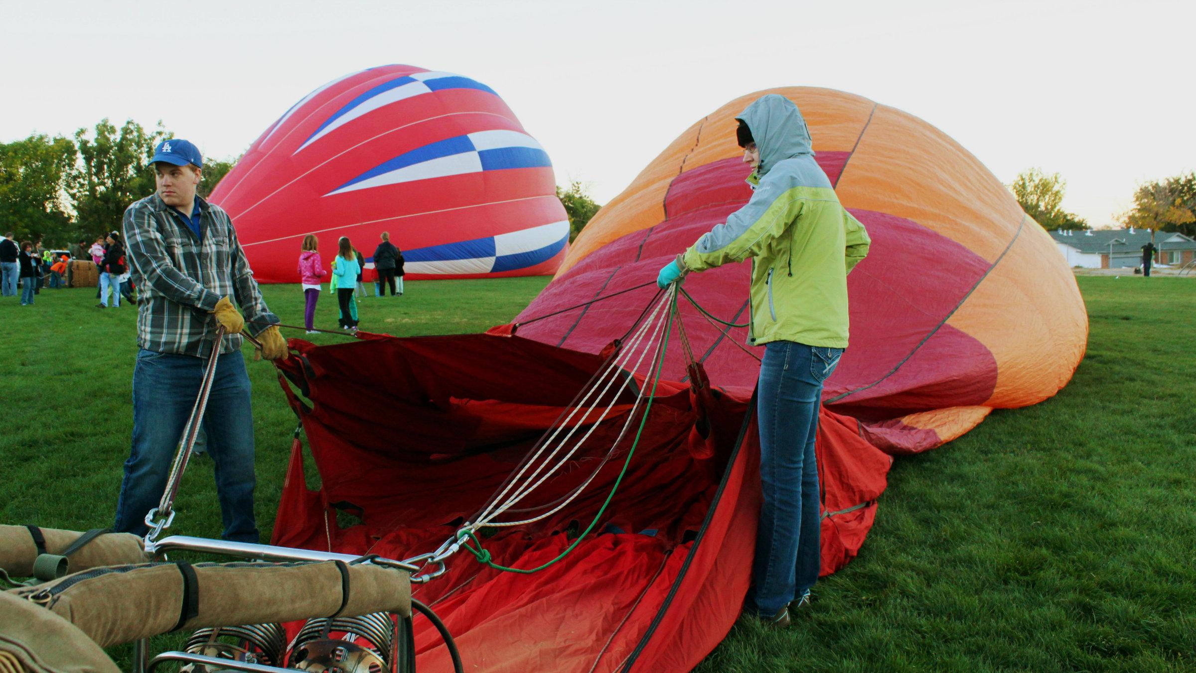 Crew members inflate a hot air balloon during the 2014 Albuquerque International Balloon Fiesta.