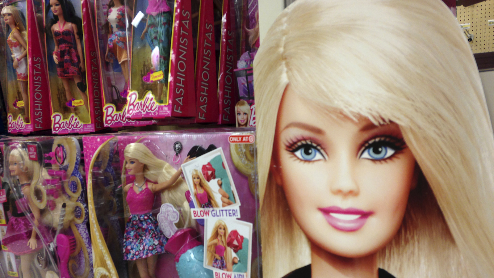 Barbie dolls are shown in the toy department of a retail store in Encinitas, California October 14, 2014.  Mattel Inc's revenue fell for the fourth straight quarter as demand for its billion-dollar brands, Barbie and Fisher-Price, slipped further, increasing pressure on the toymaker as it heads into the holiday shopping season. Picture taken October 14.    (UNITES STATES - Tags: SOCIETY BUSINESS) - RTR4AH0R
