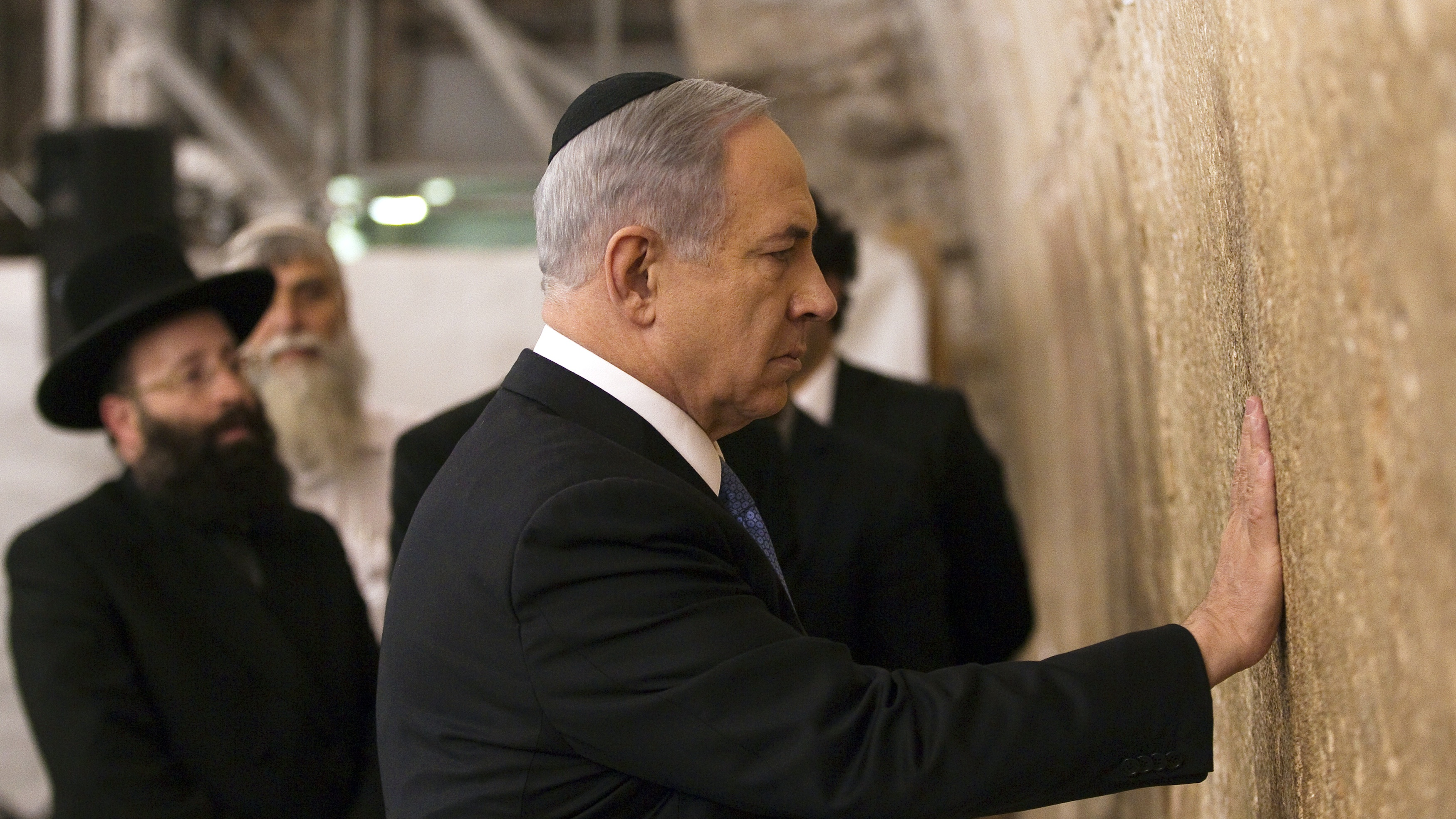 Israel's Prime Minister Benjamin Netanyahu touches the stones of the Western Wall, Judaism's holiest prayer site, in Jerusalem's Old City a day after winning Israel's election for prime minister.