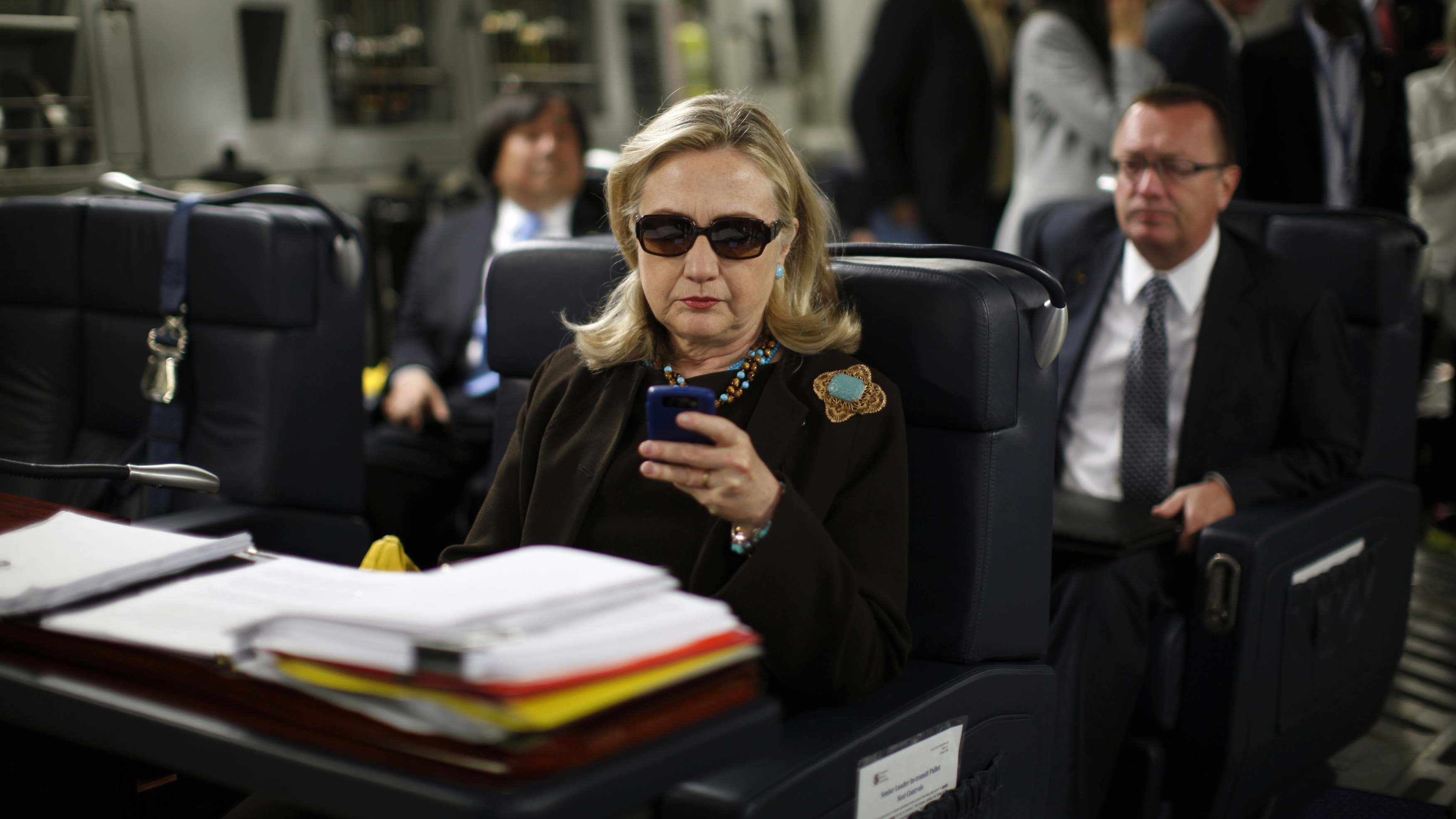 FILE - In this Oct. 18, 2011, file photo, then-Secretary of State Hillary Rodham Clinton checks her Blackberry from a desk inside a C-17 military plane upon her departure from Malta, in the Mediterranean Sea, bound for Tripoli, Libya. It's a photo that became an Internet meme: Hillary Rodham Clinton, wearing sunglasses, staring at her BlackBerry. Now it's becoming a focal point for Republicans on the House committee that's investigating the deadly attacks in Benghazi, Libya. The chairman, South Carolina Republican Trey Gowdy, wants to know why the panel has no emails from the day the photo was taken as Clinton, then the secretary of state, was en route to Tripoli.  (AP Photo/Kevin Lamarque, Pool, File)