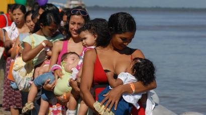 Brazilian mothers breast-feed their babies during an event organized to coincide with the opening of the Tenth National Conference on Breastfeeding