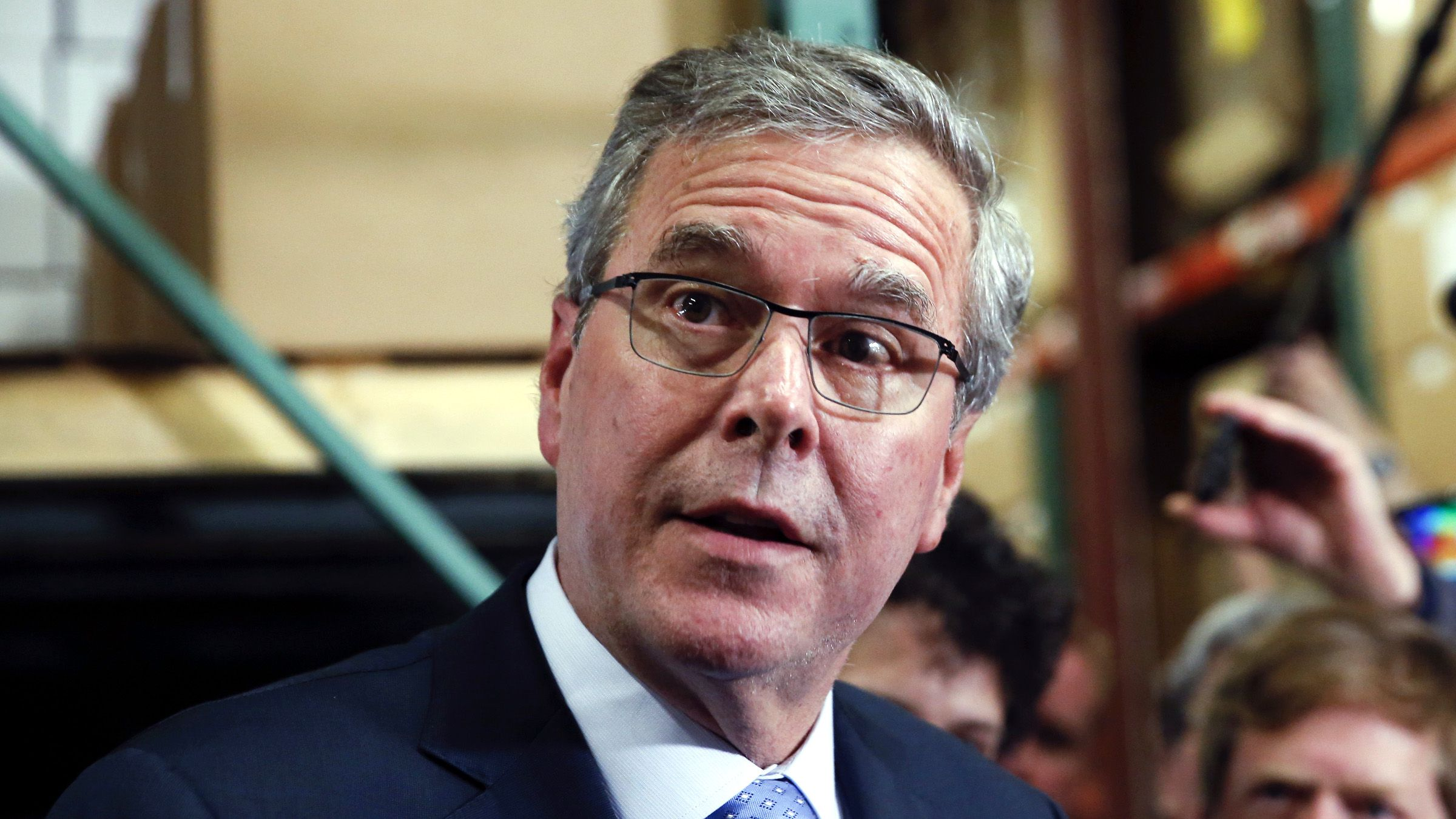 Former Florida Governor Jeb Bush talks to the media after visiting Integra Biosciences during a campaign stop in Hudson, New Hampshire March 13, 2015.