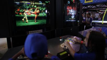 child playing fighting game