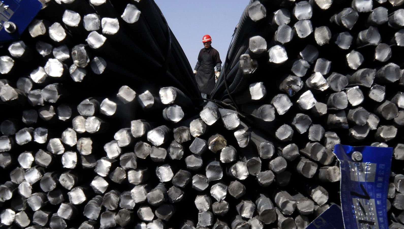 A worker stands behind truncated steel bars at a wholesale market in Changzhi, Shanxi province March 26, 2010. Profit margins at Chinese industrial enterprises have recovered to pre-crisis levels, thanks to a massive domestic stimulus plan and a rebound in demand from abroad, the National Bureau of Statistics said on Friday. REUTERS/Stringer