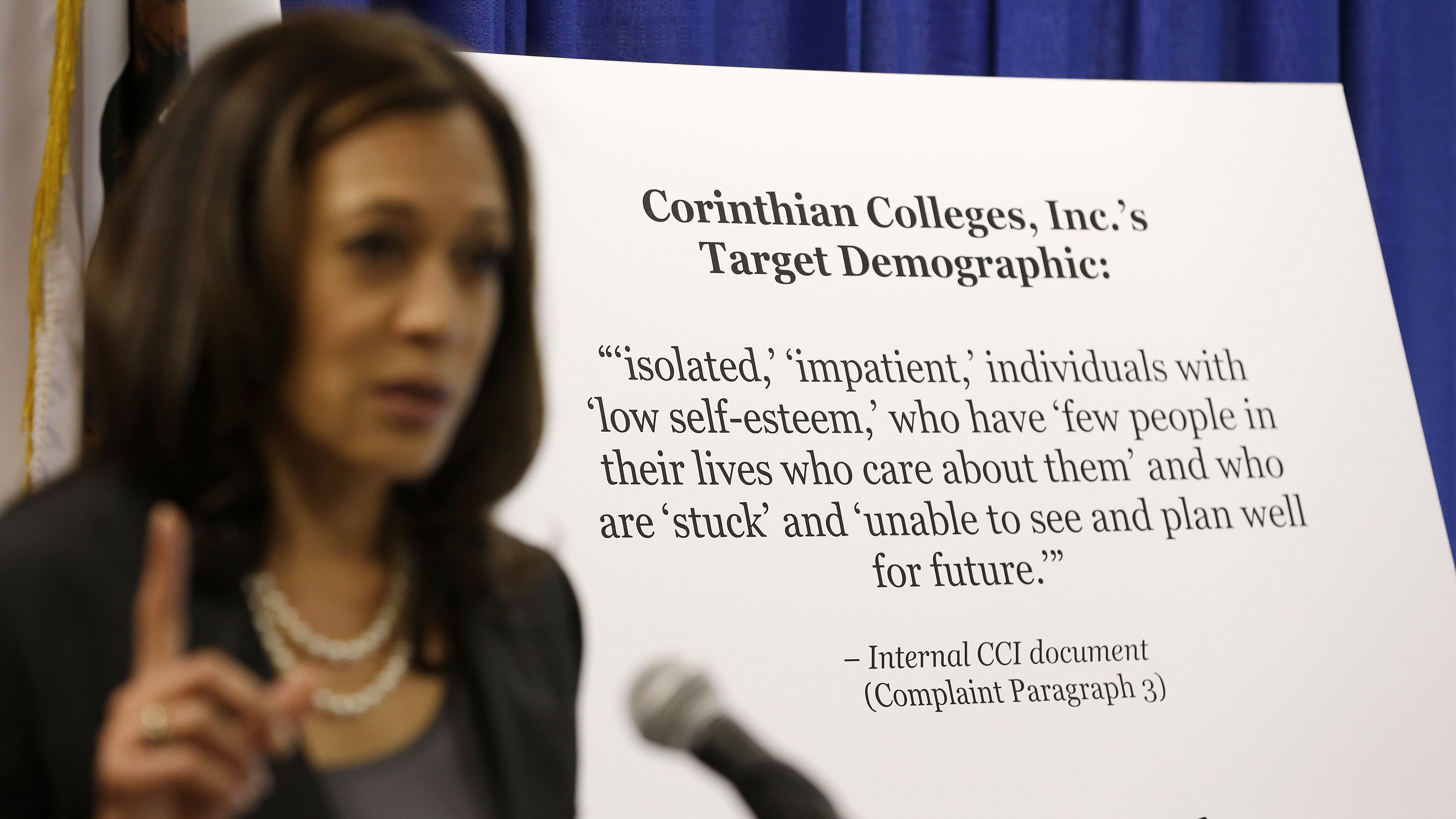 California Attorney General Kamala Harris gestures while standing by a display showing the target demographic of Corinthian Colleges during a news conference Thursday, Oct. 10, 2013, in San Francisco. California's attorney general is suing the college company, alleging it misrepresented job placement rates and school programs to lure low-income state residents. According to the AG's Office, Santa Ana-based Corinthian and its subsidiaries operate Everest, Heald and WyoTech colleges and have 81,000 students. (AP Photo/Eric Risberg)