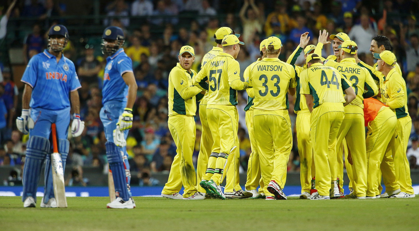 Australian team mates react after an official replay showed that India's Ravindra Jadeja (2nd L) was run out by Steve Smith during their Cricket World Cup semi-final match in Sydney, March 26, 2015.