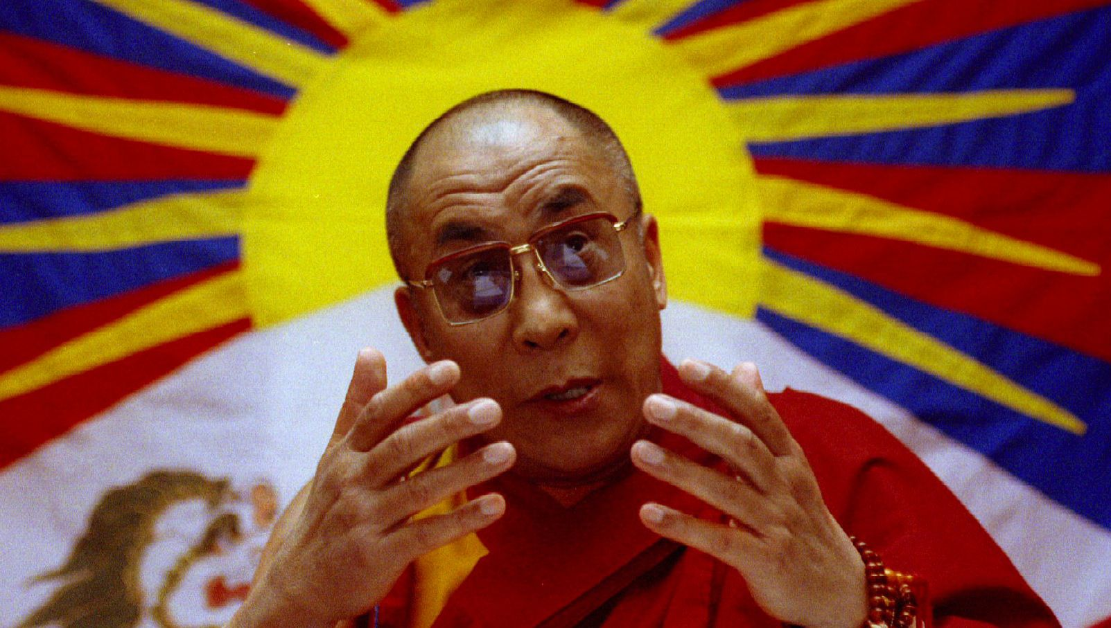 The Dalai Lama speaks at a press conference May 12, 1993 during the second week of his visit to Britain