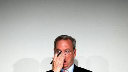 "Google Executive Chairman Eric Schmidt adjusts his spectacles during a meeting about the ""right to be forgotten"" in Madrid, Sept. 9, 2014. Google Chairman Eric Schmidt and privacy and freedom of information experts are holding the first of seven public sessions to help the company define a new ""Right to be Forgotten"" established by the European Union's top court and when it should take down search result links about citizens claiming information about them is irrelevant or obsolete."
