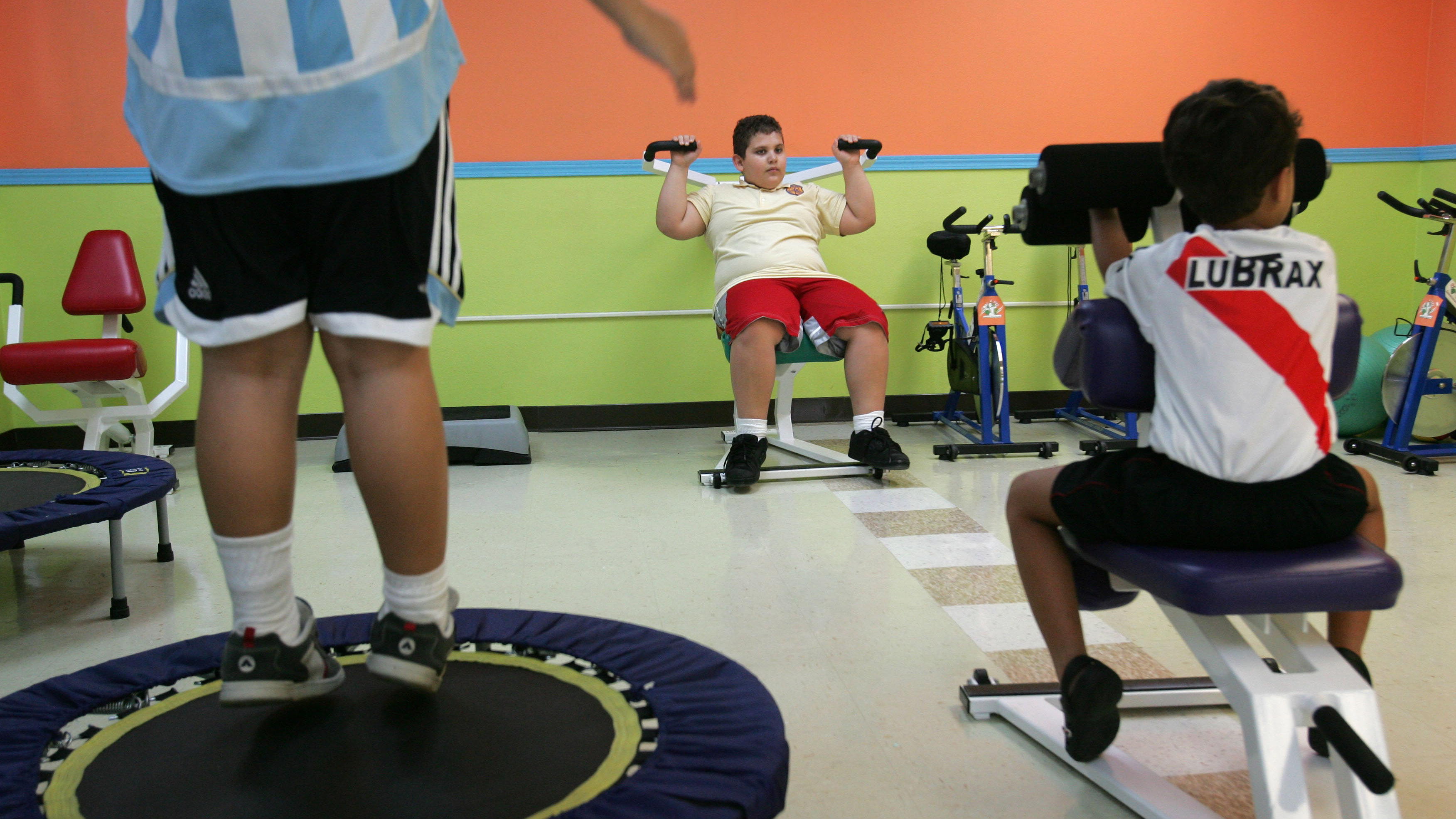 Puerto Rican boys exercise at a gym specialized in children's fitness in Guaynabo, Puerto Rico, April 20, 2007. Statistics point to a growing generation of Puerto Rican children struggling with obesity and related diseases, once rarely seen among such young people. The problem is worse here than on the U.S. mainland: Studies show 26 percent of youngsters are obese, compared to 18 percent on the U.S. mainland.