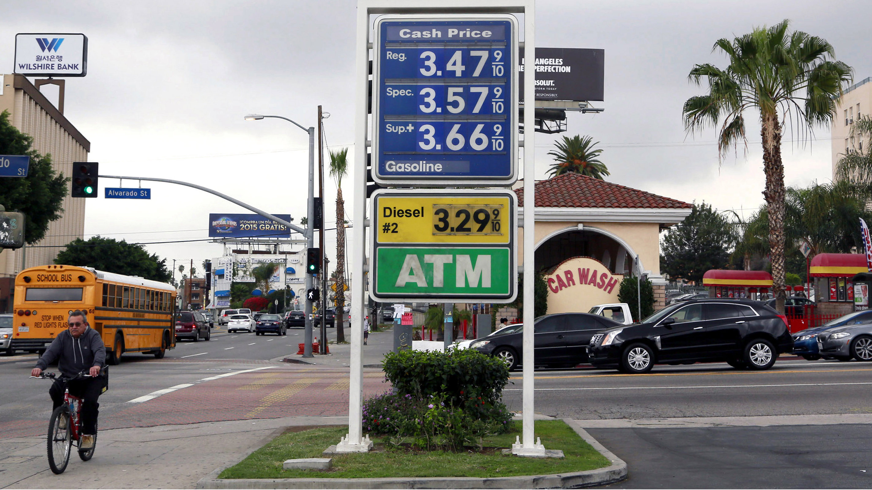 In this Feb. 27, 2015 file photo, a cyclist rides by a sign at a gas station in Los Angeles posting the latest gas prices. Lawmakers will hear testimony Tuesday, March 24, 2015, on the recent wild swings in gasoline prices and will look at what state regulators can do about it. Gas prices soared as much as 25 cents a gallon last month after an explosion stopped gasoline production at an Exxon Mobil refinery in Southern California. Oil producers and consumer advocates are among those scheduled to testify.