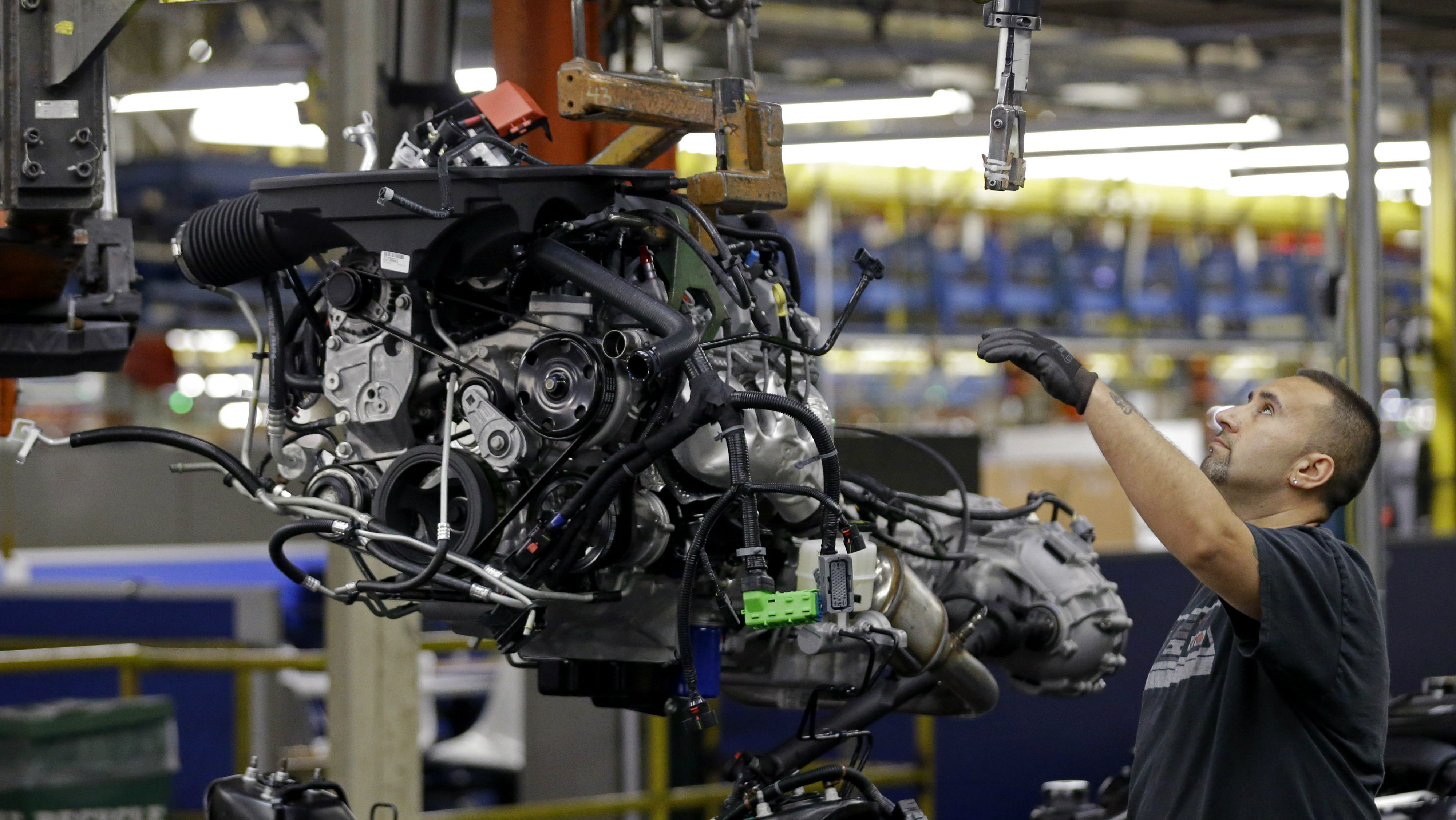 An auto worker assembles an SUV at the General Motors auto plant in Arlington, Texas, Tuesday, May 13, 2014. (AP Photo/LM Otero)