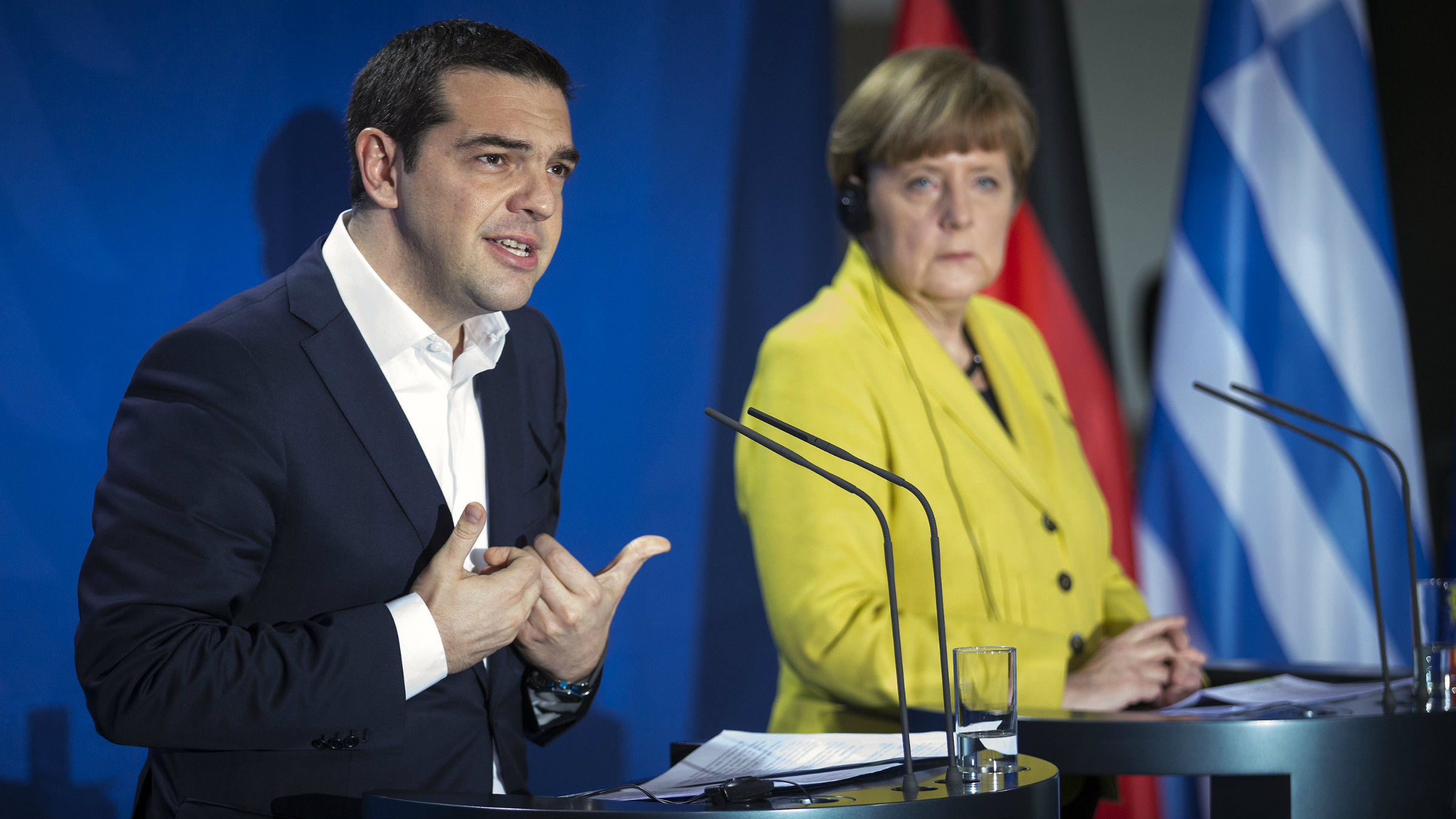 German Chancellor Angela Merkel and Greek Prime Minister Alexis Tsipras address a news conference following talks at the Chancellery in Berlin March 23, 2015. Germany sees all partners in Europe as its equals despite having the largest economy and wants good relations with all of them including Greece, Merkel said on Monday after talks with Tsipras. REUTERS/Hannibal Hanschke