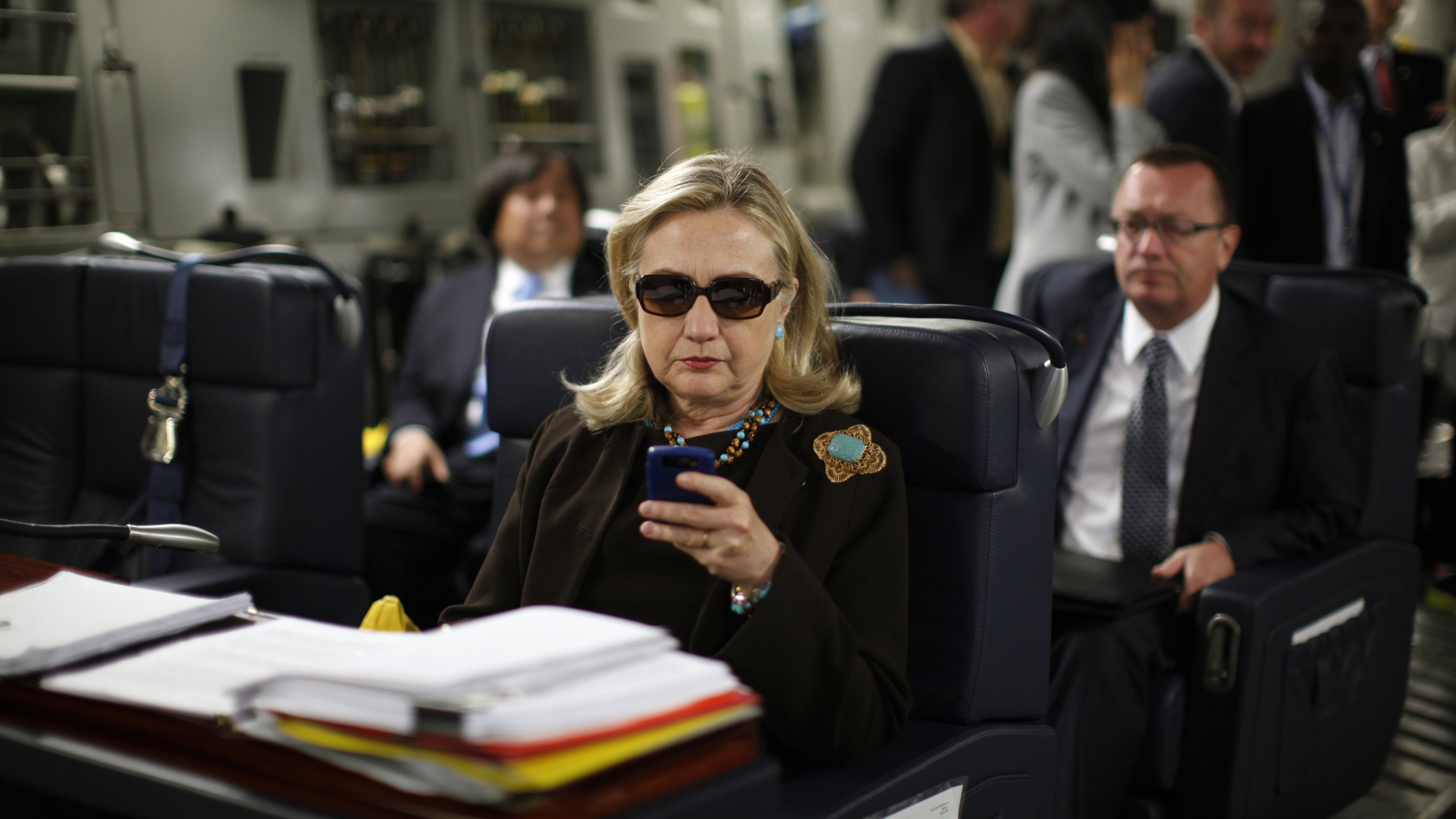 hilary clinton checking phone email