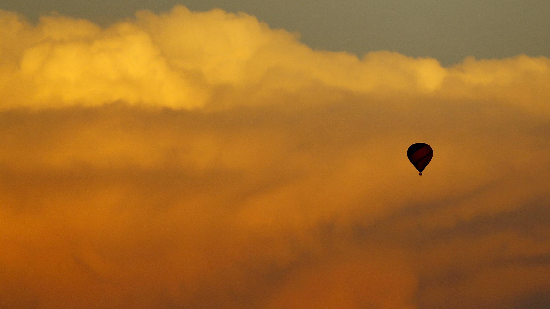 hot air balloon among clouds