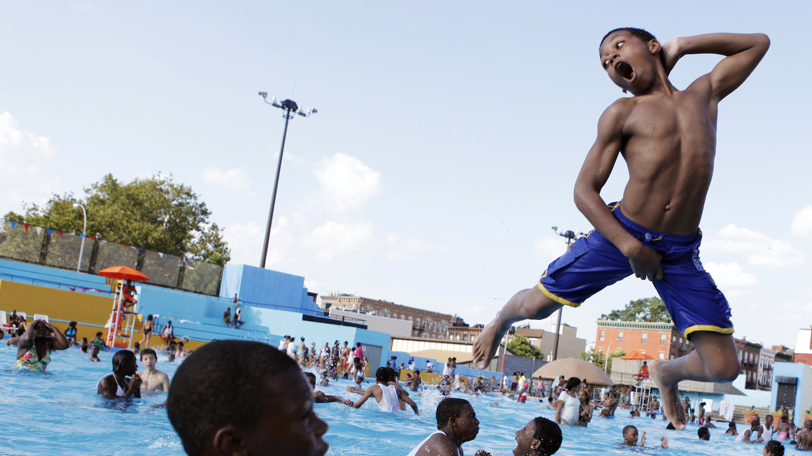 A boy jumps into the water at Kosciuszko Pool in Brooklyn on a hot summer day in New York July 12, 2011.  REUTERS/Lucas Jackson (UNITED STATES - Tags: SOCIETY ENVIRONMENT IMAGES OF THE DAY) - RTR2OT4Z