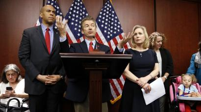 U.S. Senator Cory Booker (D-NJ) (from 2nd L), Senator Rand Paul (R-KY), and Senator Kirsten Gillibrand (D-NY) hold a news conference, to introduce legislation that would prevent the federal government from prosecuting medical marijuana users in states where it is legal, at the U.S. Capitol in Washington, March 10, 2015. Also pictured are medical marijuana patients Sandy Faiola (L) from New Jersey and Morgan Jones (bottom R), a 4-year-old Druvet syndrome sufferer from New York.