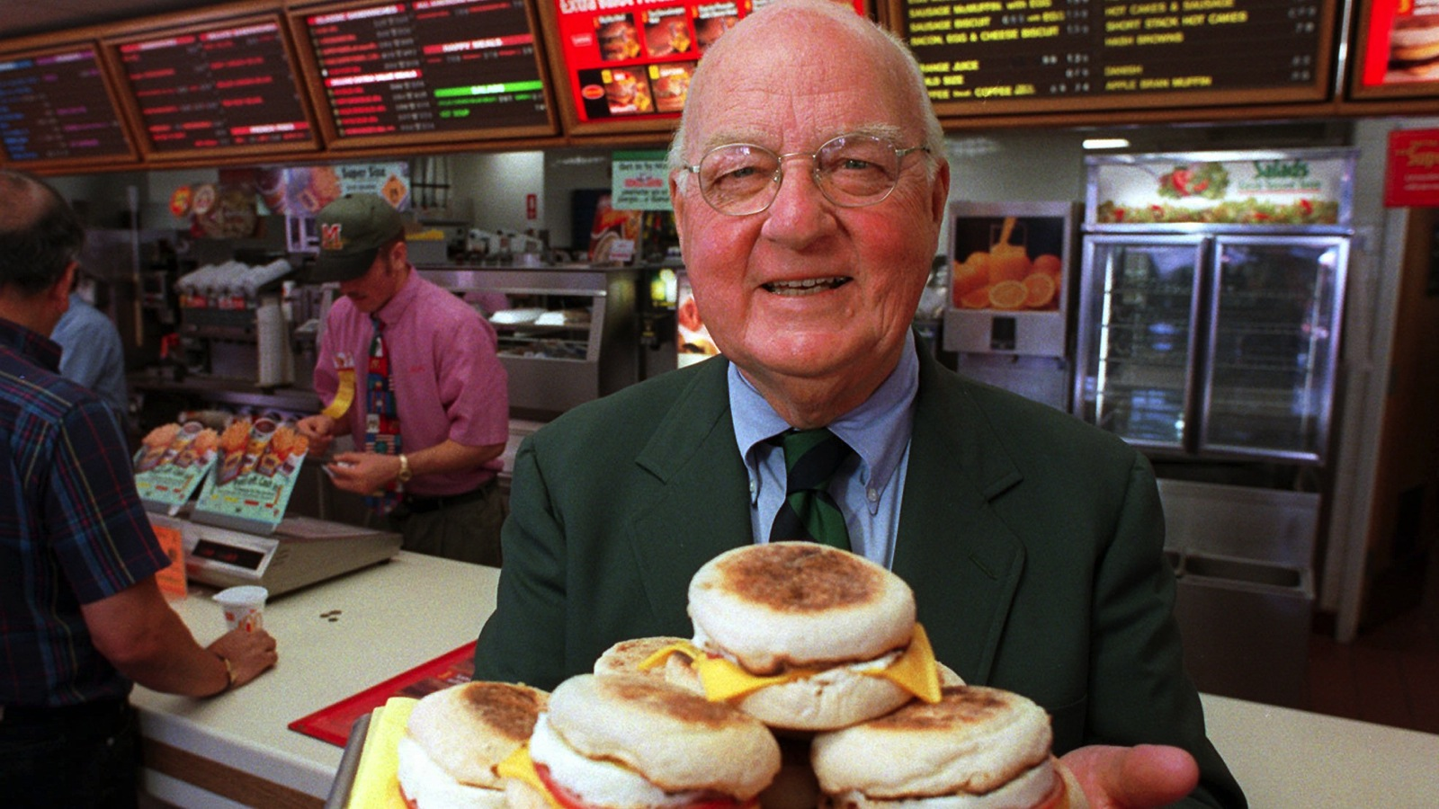 **FILE**Herb Peterson, the creator of the Egg McMuffin, shows off his invention in this April 1997 file photo, at one of his McDonald's franchises in Santa Barbara, Calif. Peterson, 89