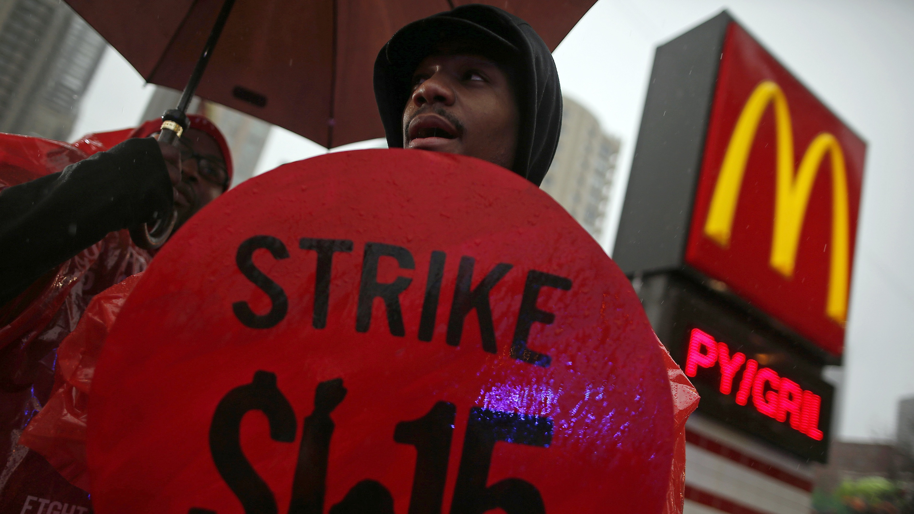 Demonstrators protest for higher wages in front of a McDonald's restaurant in Chicago.