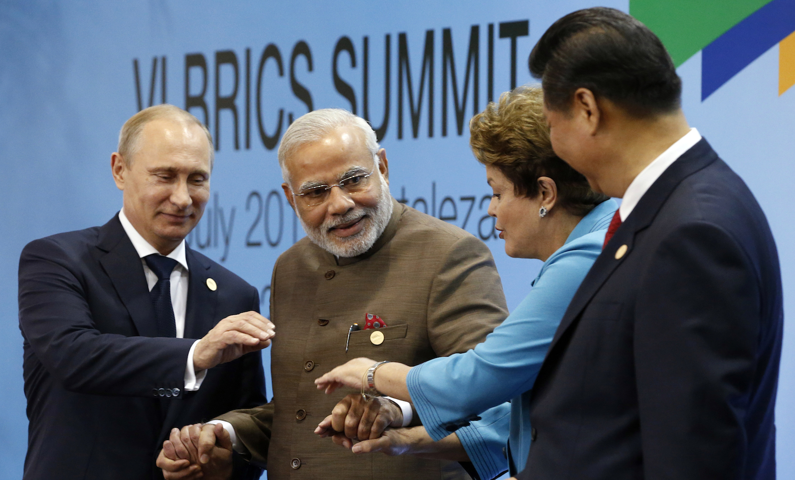 Russia's President Vladimir Putin, India's Prime Minister Narendra Modi, Brazil's President Dilma Rousseff and China's President Xi Jinping pose for a group picture.