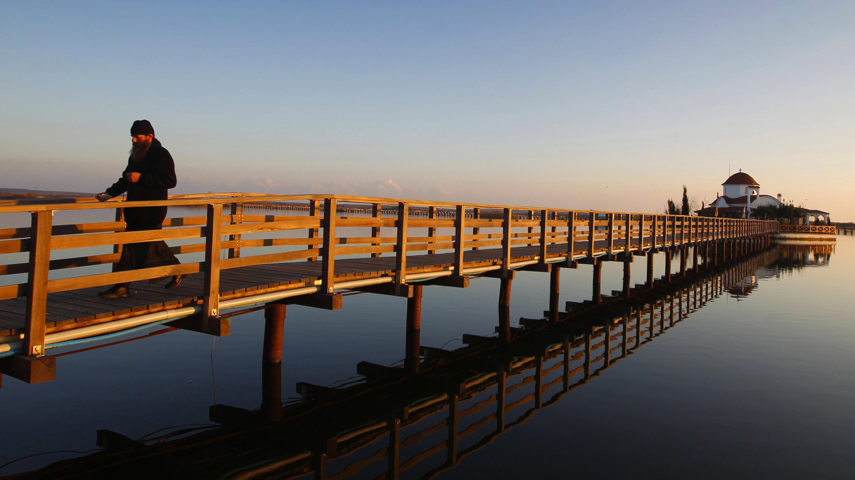 monk on a bridge