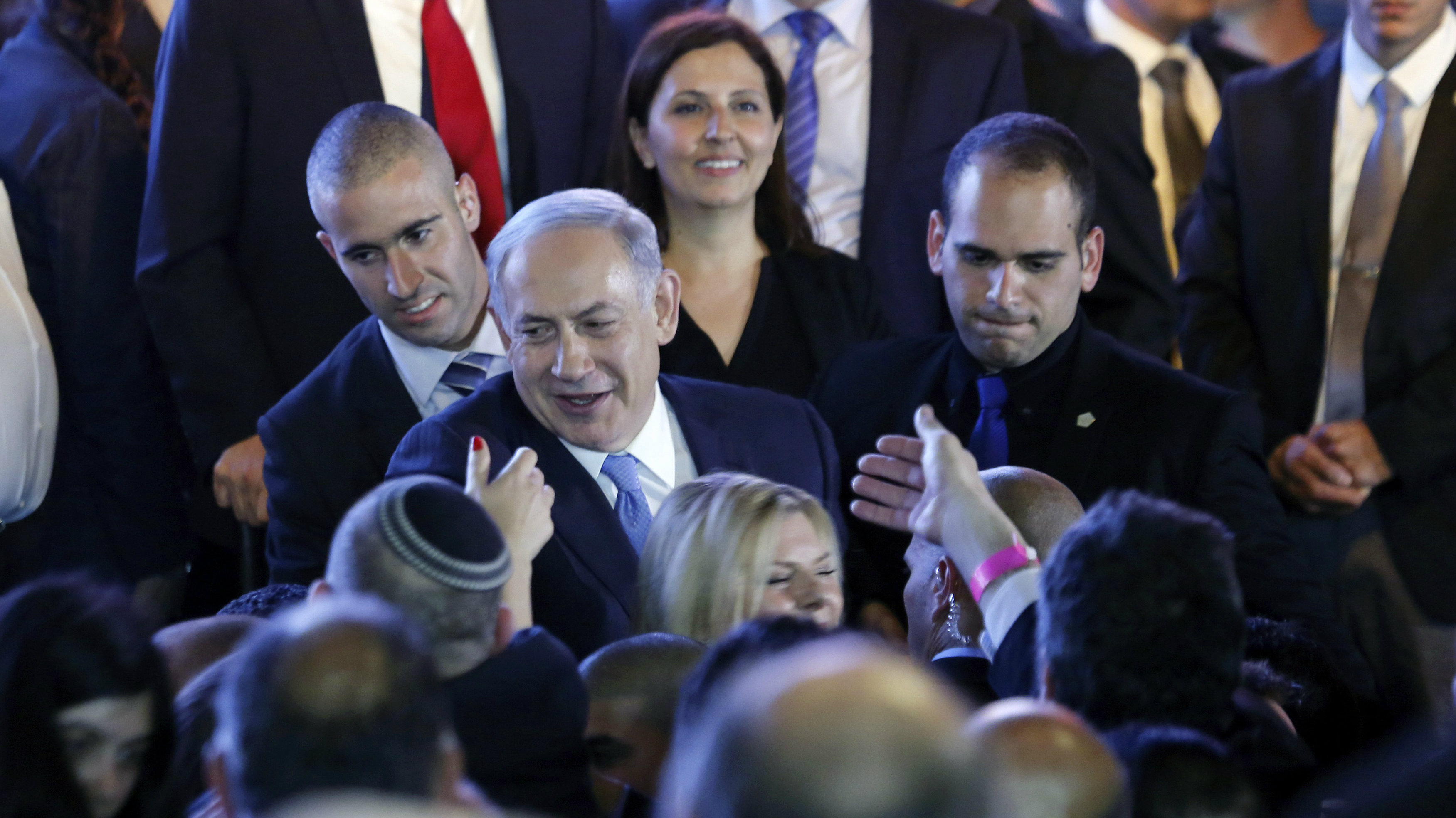 Israeli Prime Minister Benjamin Netanyahu (C) greets supporters at party headquarters in Tel Aviv March 18, 2015.