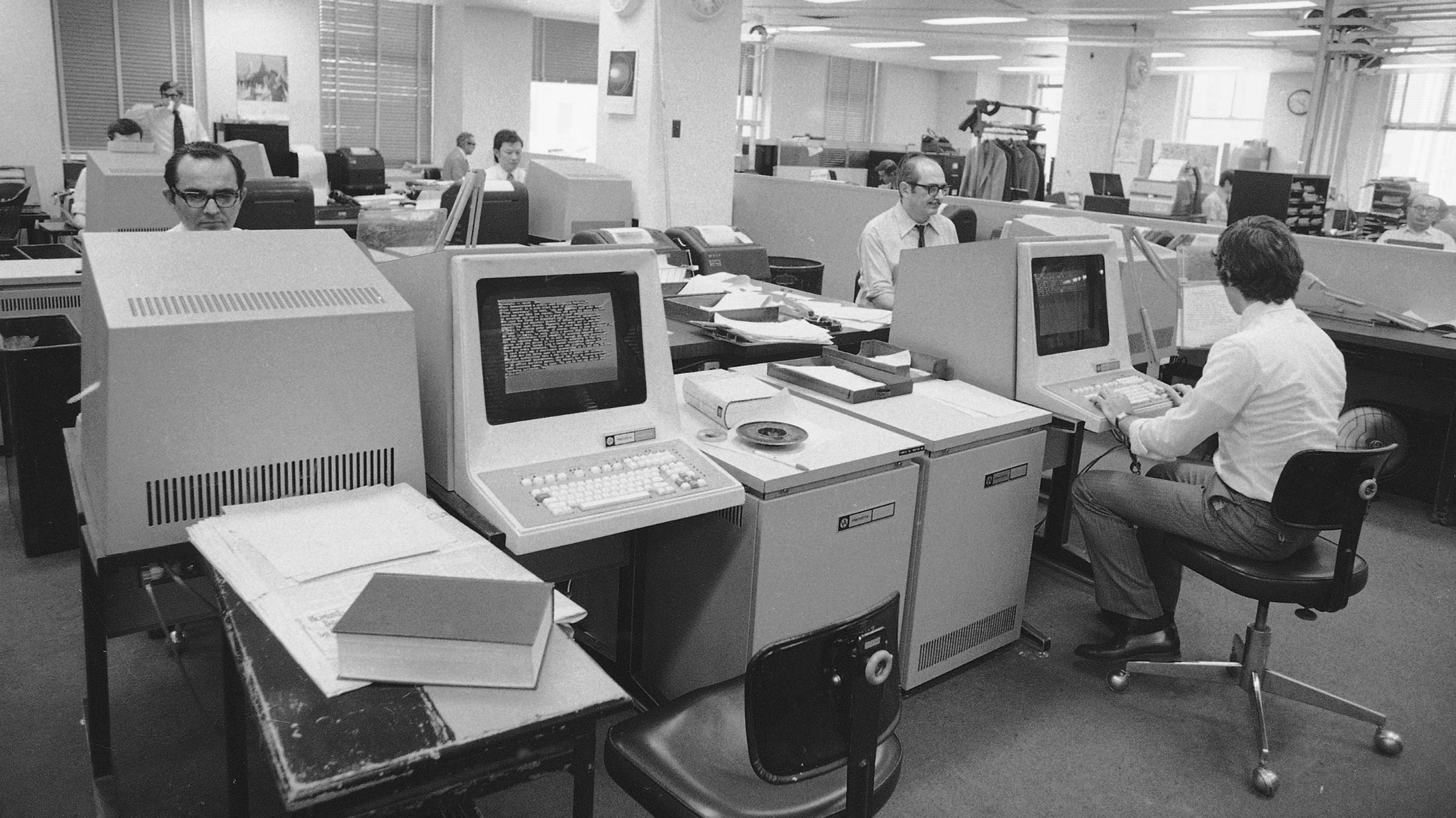 The Latin American and World Services desks at Associated Press headquarters in New York is seen, March 27, 1973. (AP Photo/Marty Lederhandler)