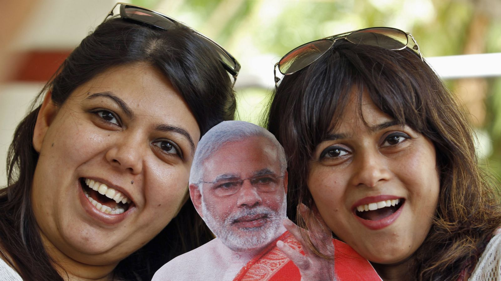 Supporters pose with a cut-out of Narendra Modi.