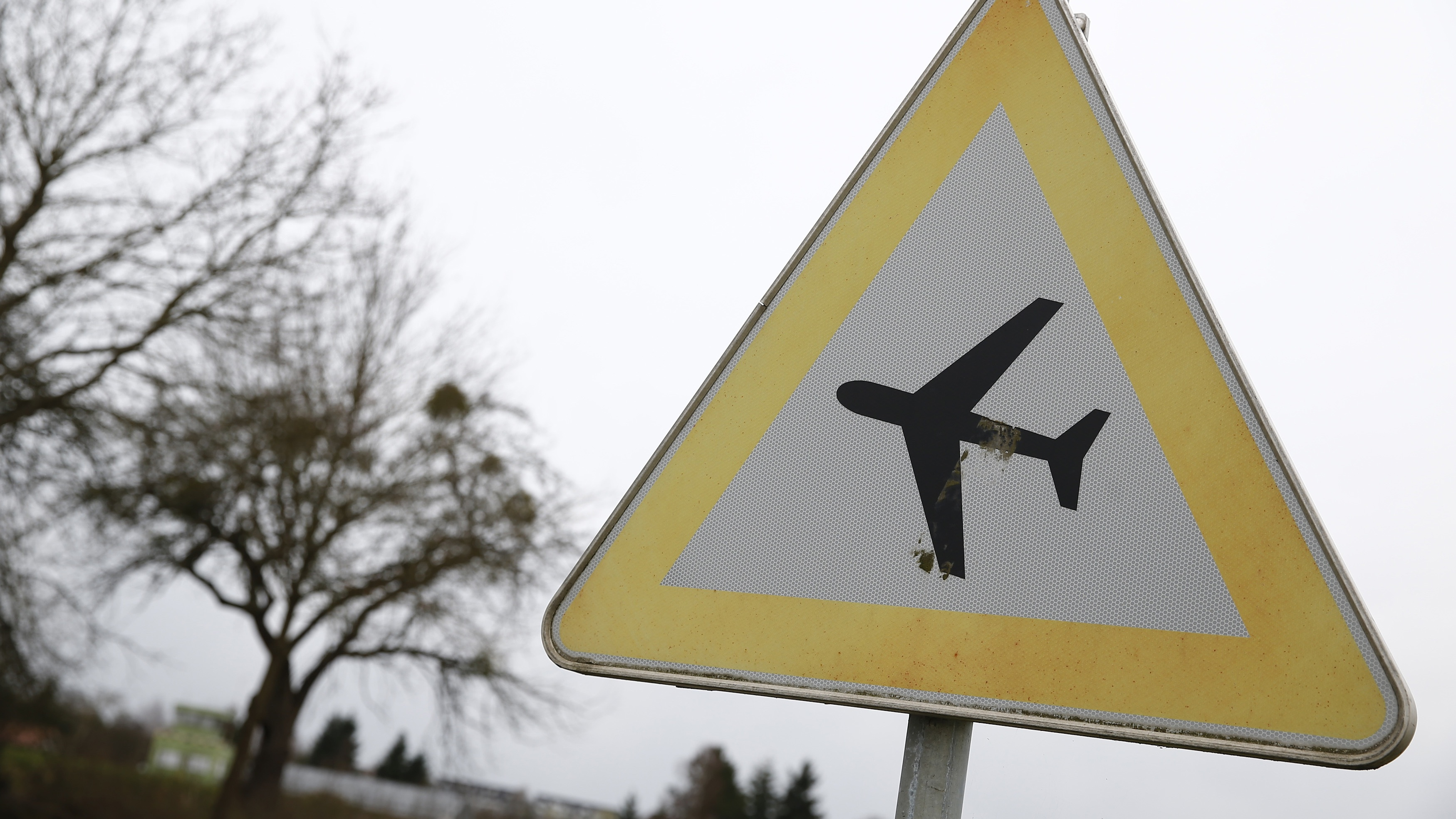 A traffic sign warning of low flying aircraft stands near to LSC Westerwald flight club, where Germanwings co-pilot Andreas Lubitz had been a member, in Montabaur March 26, 2015.