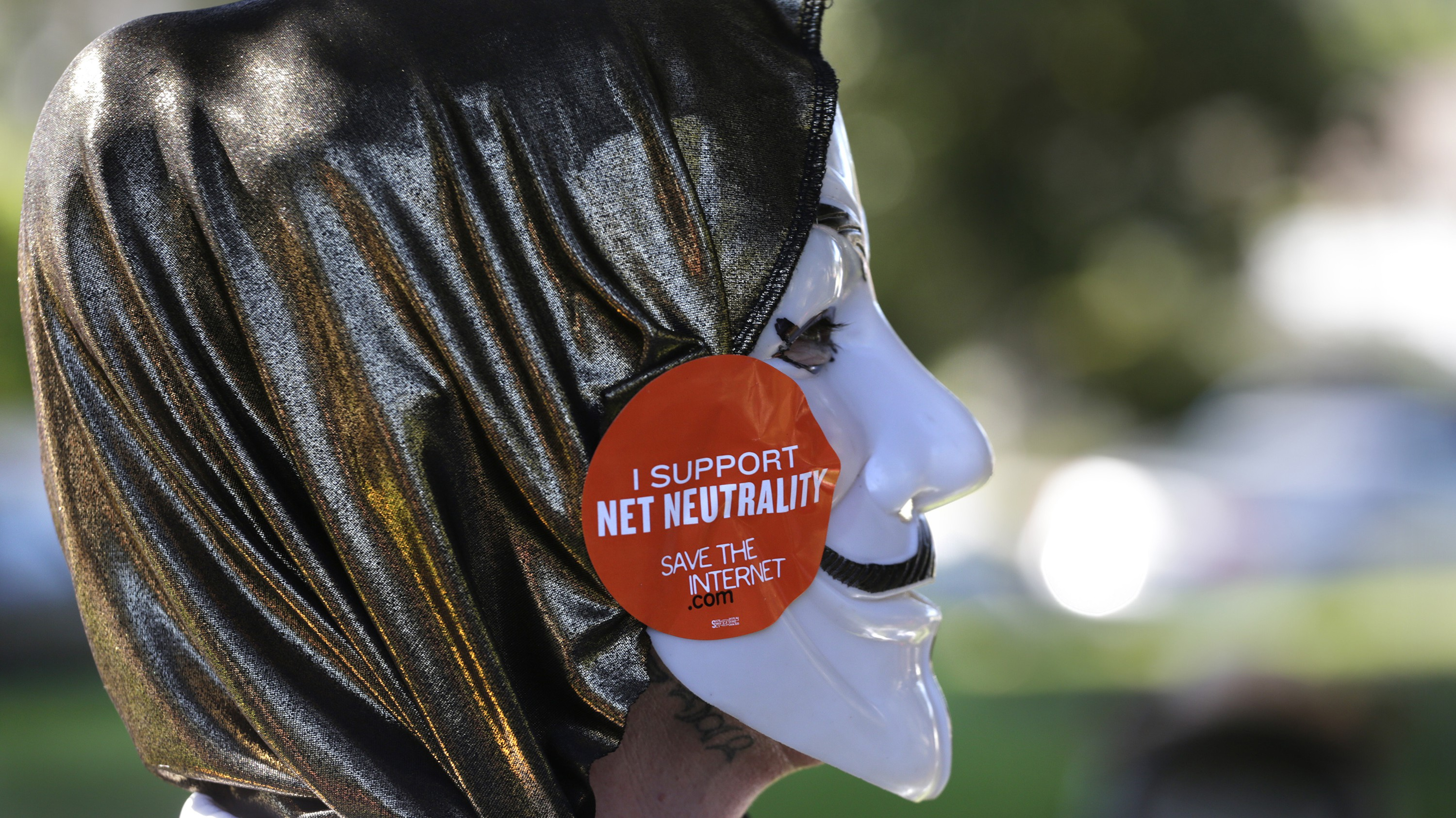 Net neutrality advocate in a Guy Fawkes mask
