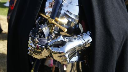 A reenactor wears armour at the site of the Battle of Bosworth.